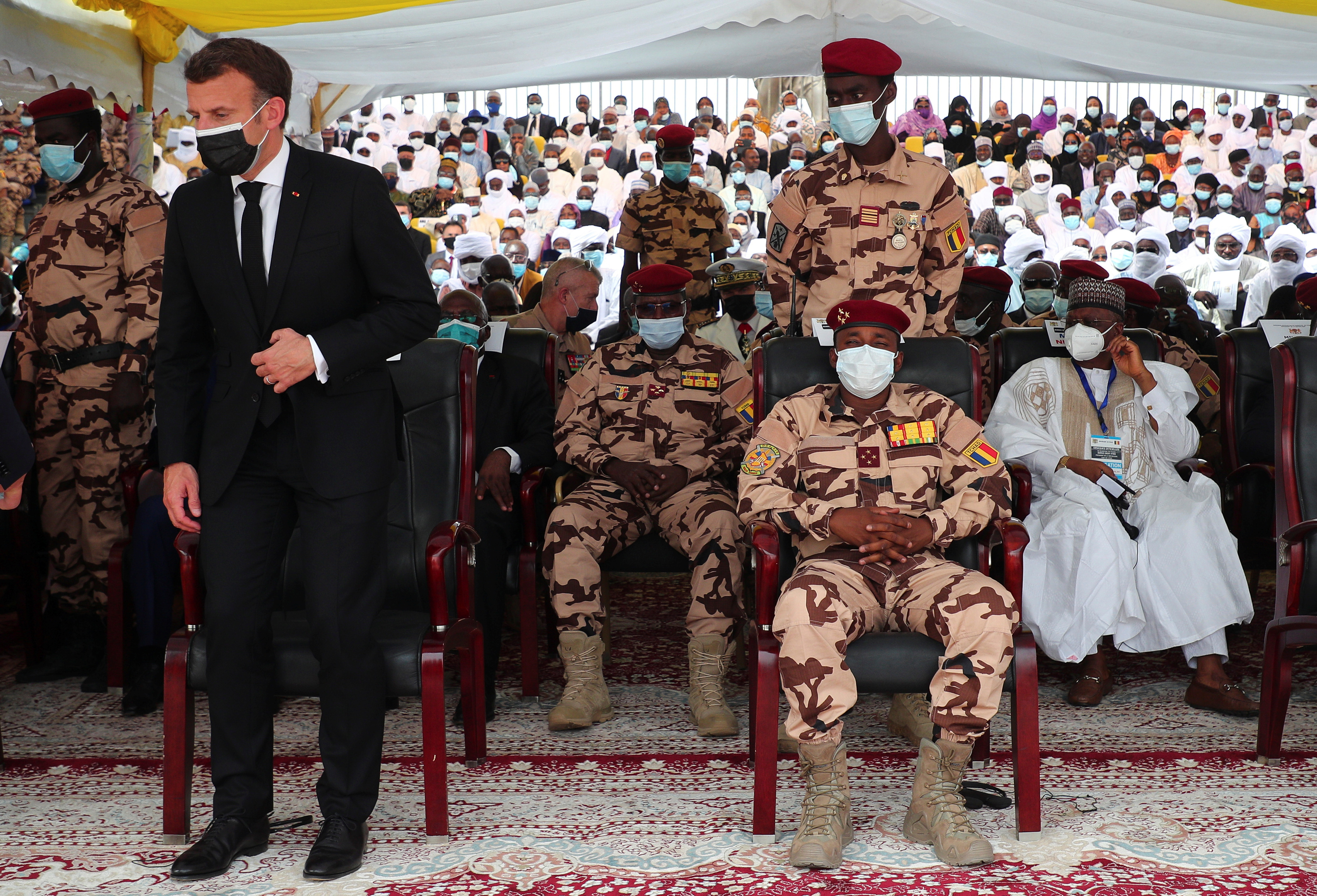 French President Emmanuel Macron takes his seat in the front row next to Mahamat Idriss Deby, son of the late Chad's president, during the state funeral for the late Chadian President Idriss Deby in N'Djamena, Chad April 23, 2021. Christophe Petit Tesson/Pool via REUTERS
