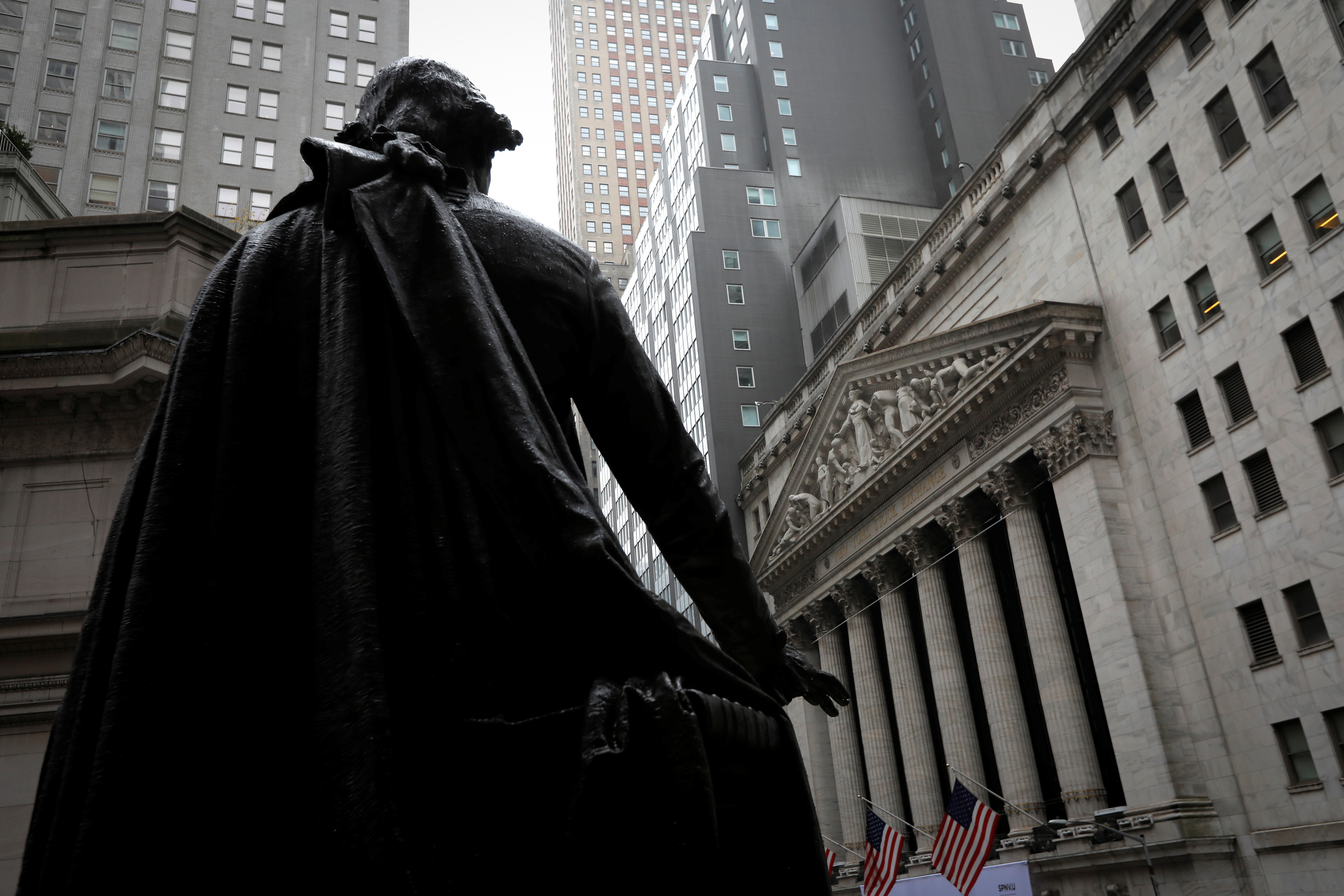 A statue of George Washington stands at Federal Hall across Wall Street from the New York Stock Exchange in New York City. REUTERS/Mike Segar