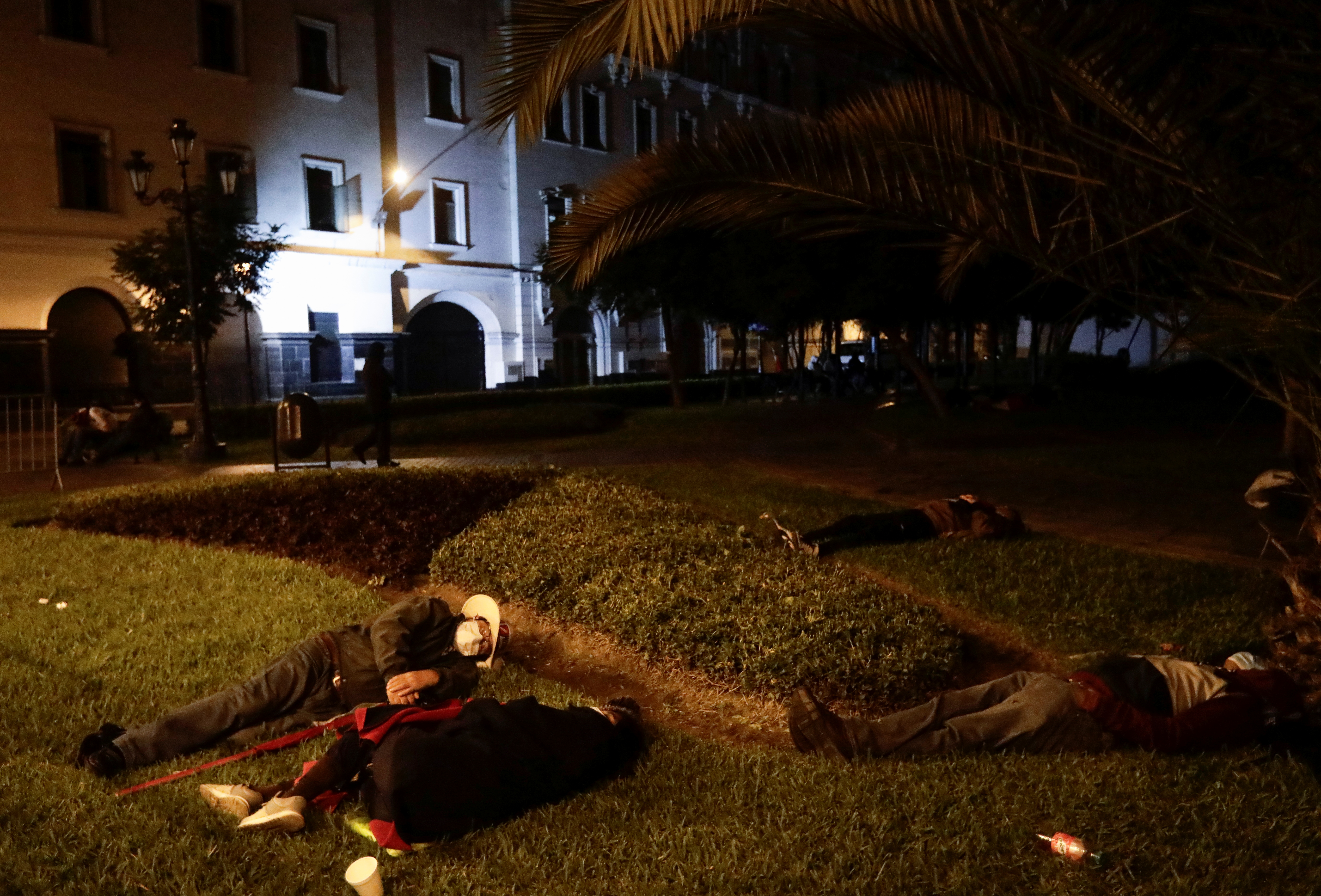 Supporters of Peru's presidential candidate Pedro Castillo sleep across the street from the National Jury of Elections, in Lima, Peru June 10, 2021. REUTERS/Angela Ponce