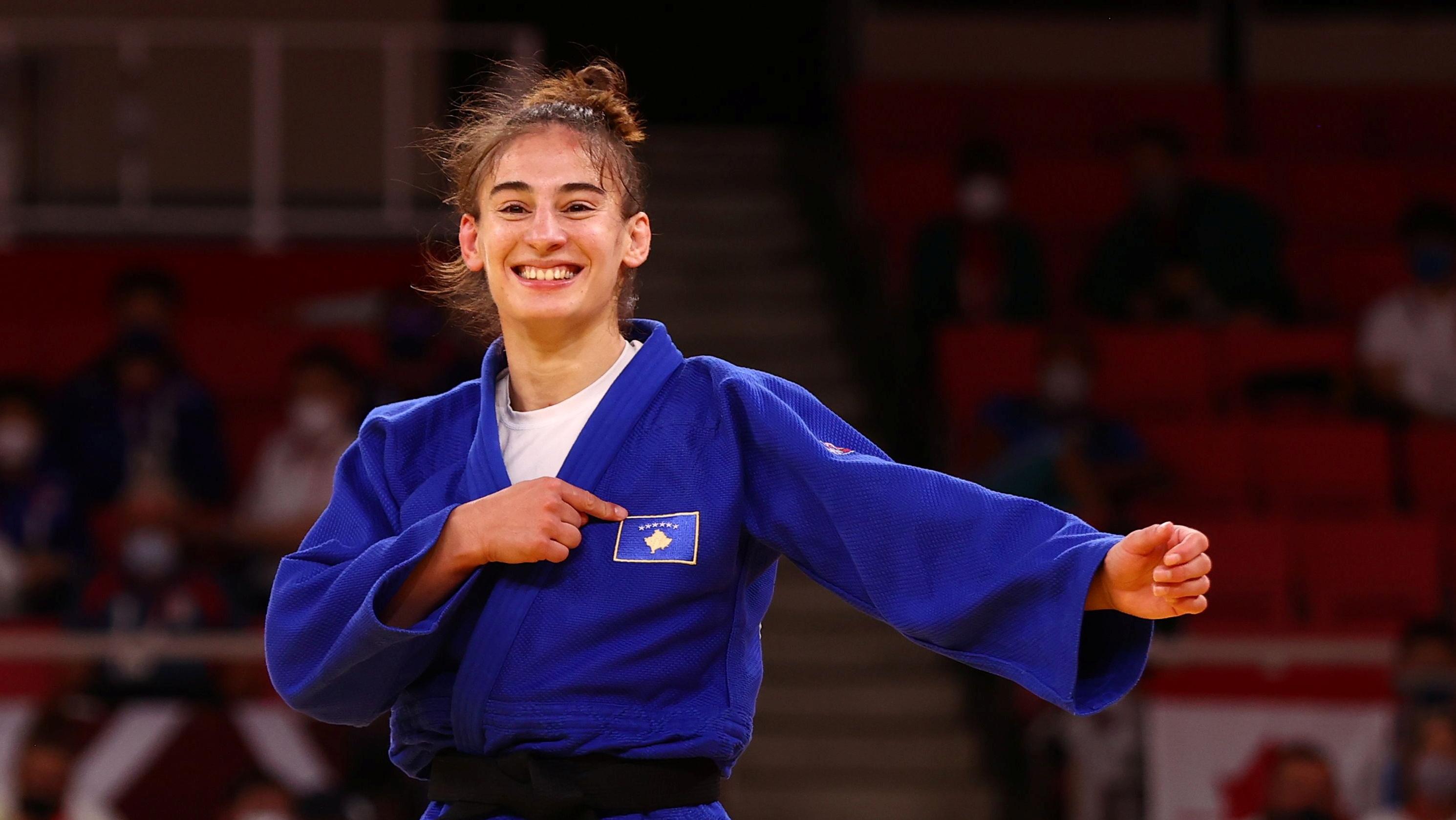 Tokyo 2020 Olympics - Judo - Women's 57kg - Gold medal match - Nippon Budokan - Tokyo, Japan - July 26, 2021. Nora Gjakova of Kosovo celebrates after winning gold REUTERS/Sergio Perez