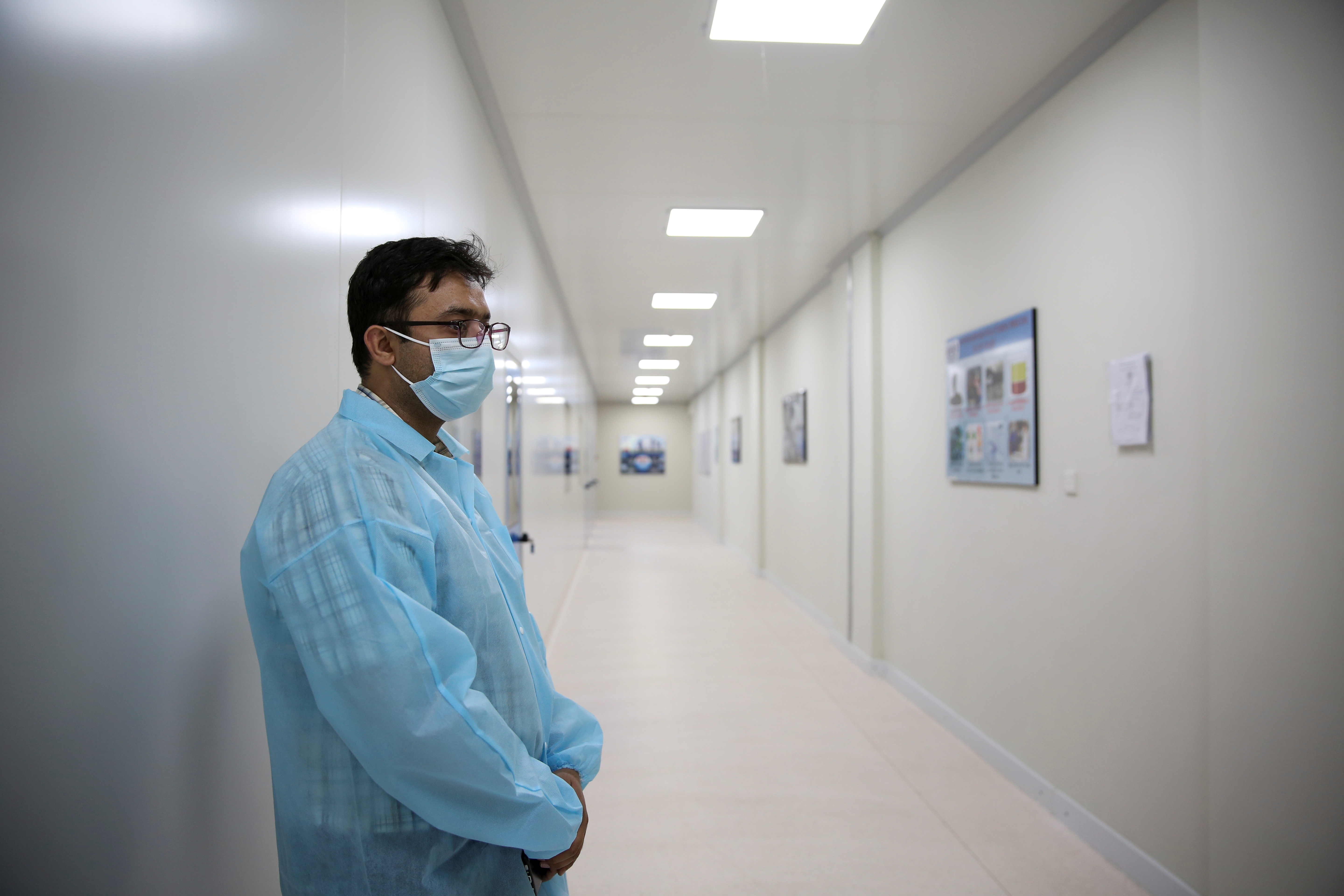 Dr. Omar Saeed, the project coordinator who was part of phase 3 trials of the PakVac coronavirus disease (COVID-19) vaccine, which is being produced locally, stands at the premises of the National Institute of Health (NIH) in Islamabad, Pakistan June 3, 2021. Picture taken June 3, 2021. REUTERS/Saiyna Bashir