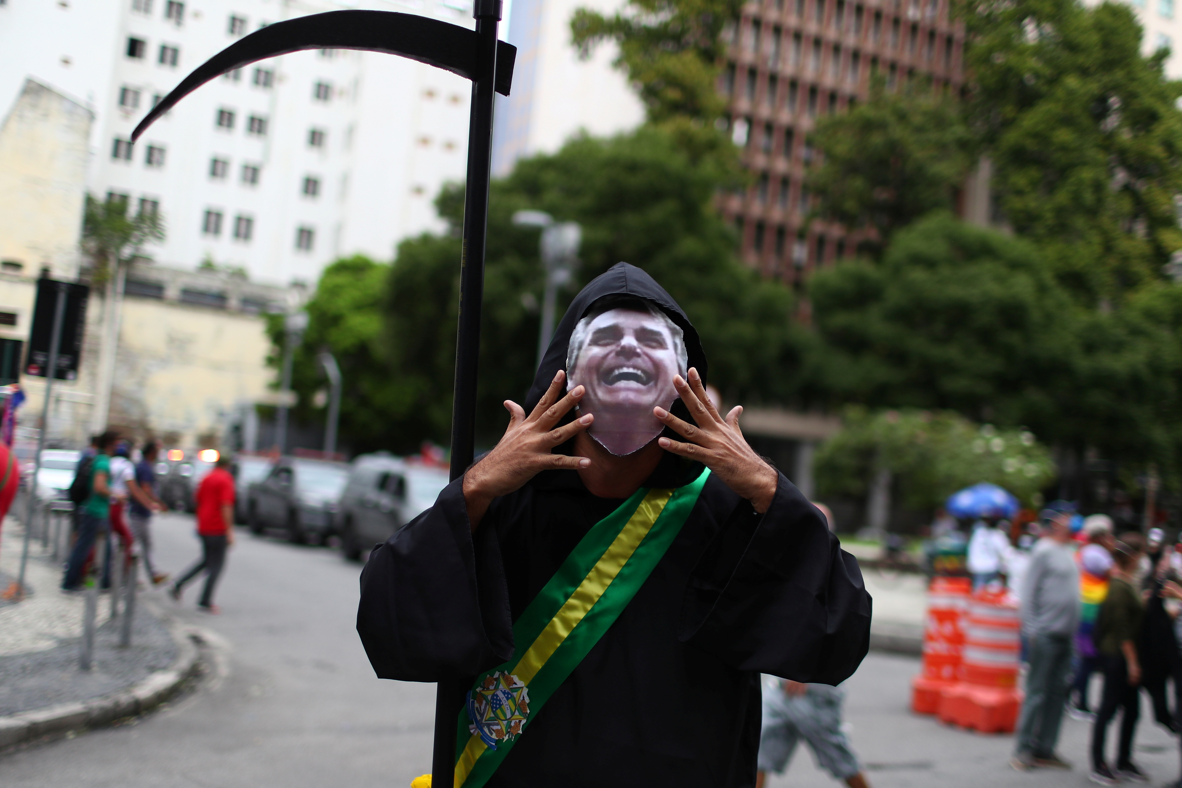 A person dressed up as the grim reaper attends a demonstration against Brazil's President Jair Bolsonaro's handling of the coronavirus disease (COVID-19) pandemic and to impeach him, in Rio de Janeiro, Brazil, June 19, 2021. REUTERS/Pilar Olivares