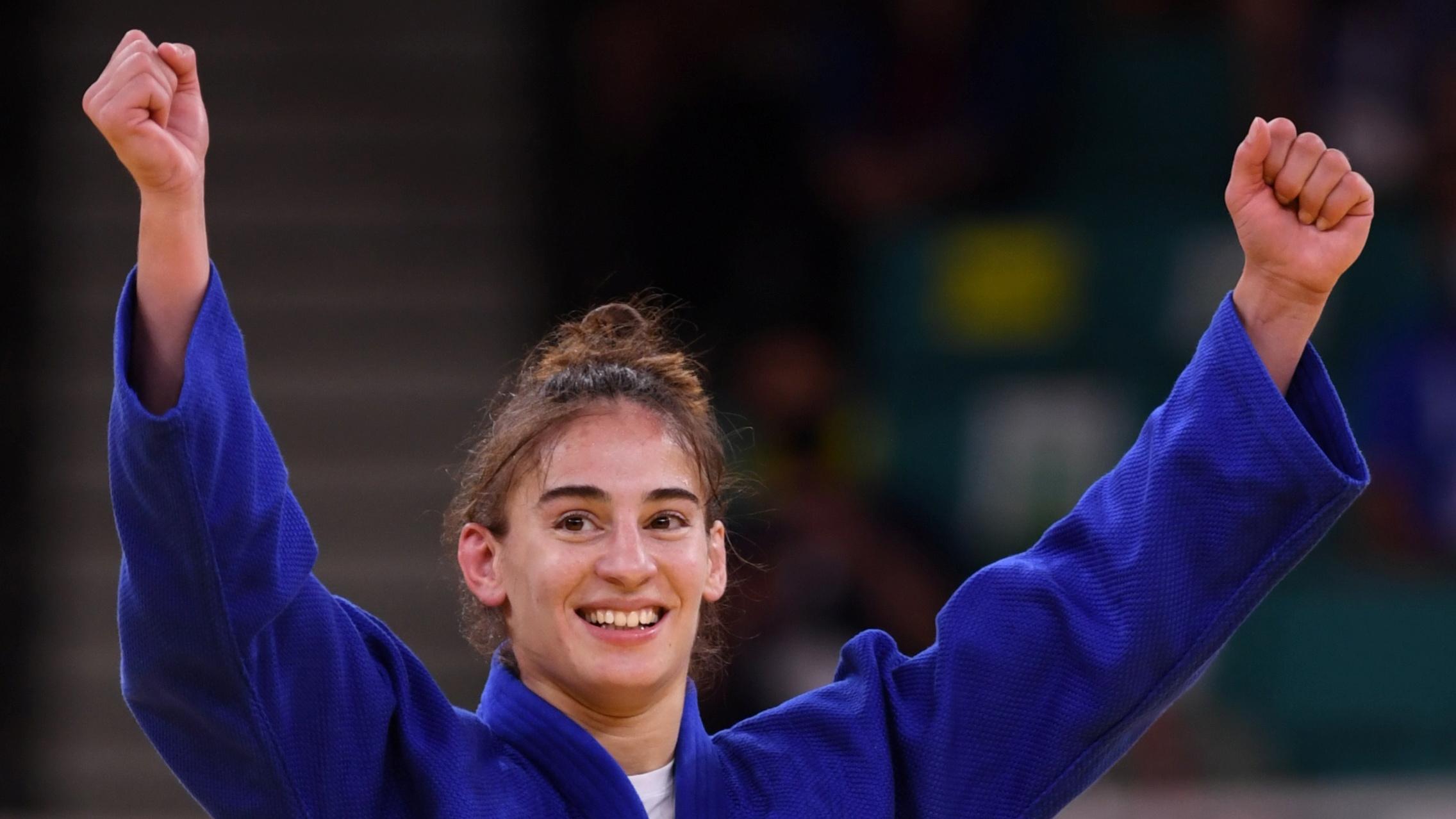 Tokyo 2020 Olympics - Judo - Women's 57kg - Gold medal match - Nippon Budokan - Tokyo, Japan - July 26, 2021. Nora Gjakova of Kosovo celebrates after winning gold against Sarah Leonie Cysique of France REUTERS/Annegret Hilse