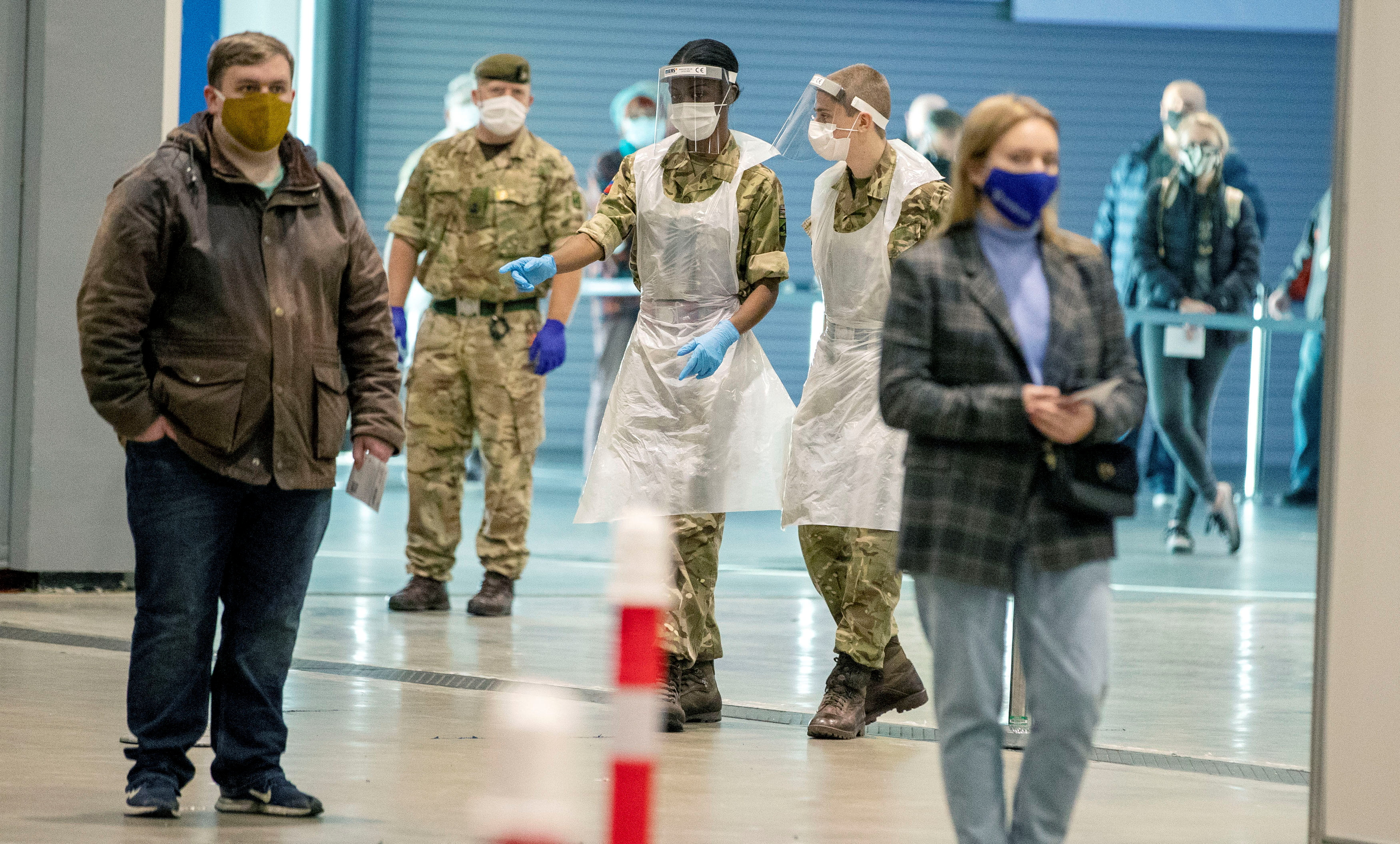 Soldiers direct people at The Exhibition Centre, which has been set up as a testing centre as part of the mass coronavirus disease (COVID-19) testing, in Liverpool, Britain, November 6, 2020. Peter Byrne/PA Wire/Pool via REUTERS/File Photo