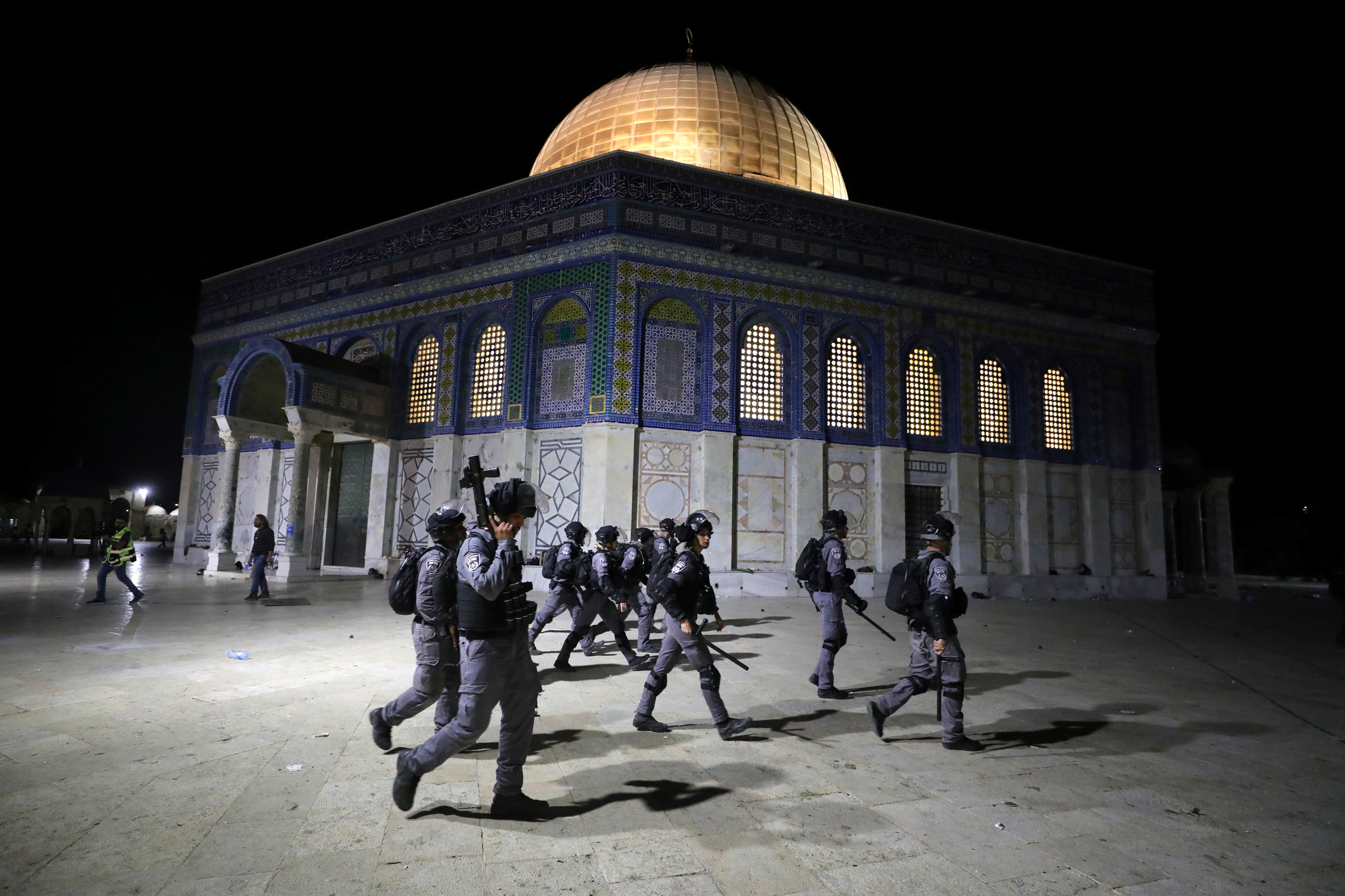 Israeli police walk near the Dome of the Rock during clashes with Palestinians at a compound known to Muslims as Noble Sanctuary and to Jews as Temple Mount, amid tension over the possible eviction of several Palestinian families from homes on land claimed by Jewish settlers in the Sheikh Jarrah neighbourhood, in Jerusalem's Old City, May 7, 2021. REUTERS/Ammar Awad