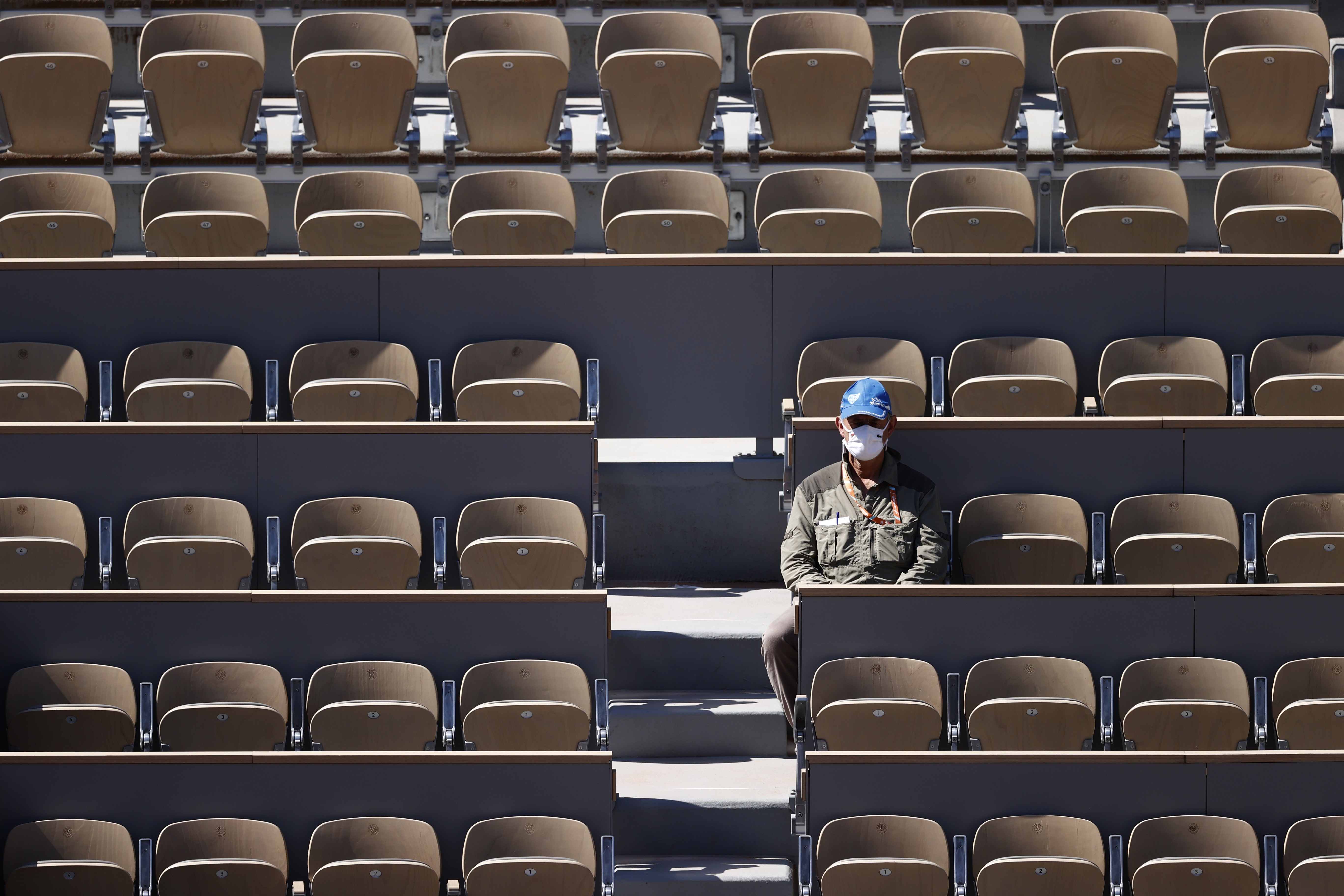 Tennis - French Open - Roland Garros, Paris, France - May 30, 2021 A man is seen in an empty stand during the first round match between Romania's Patricia Maria Tig and Japan's Naomi Osaka REUTERS/Christian Hartmann
