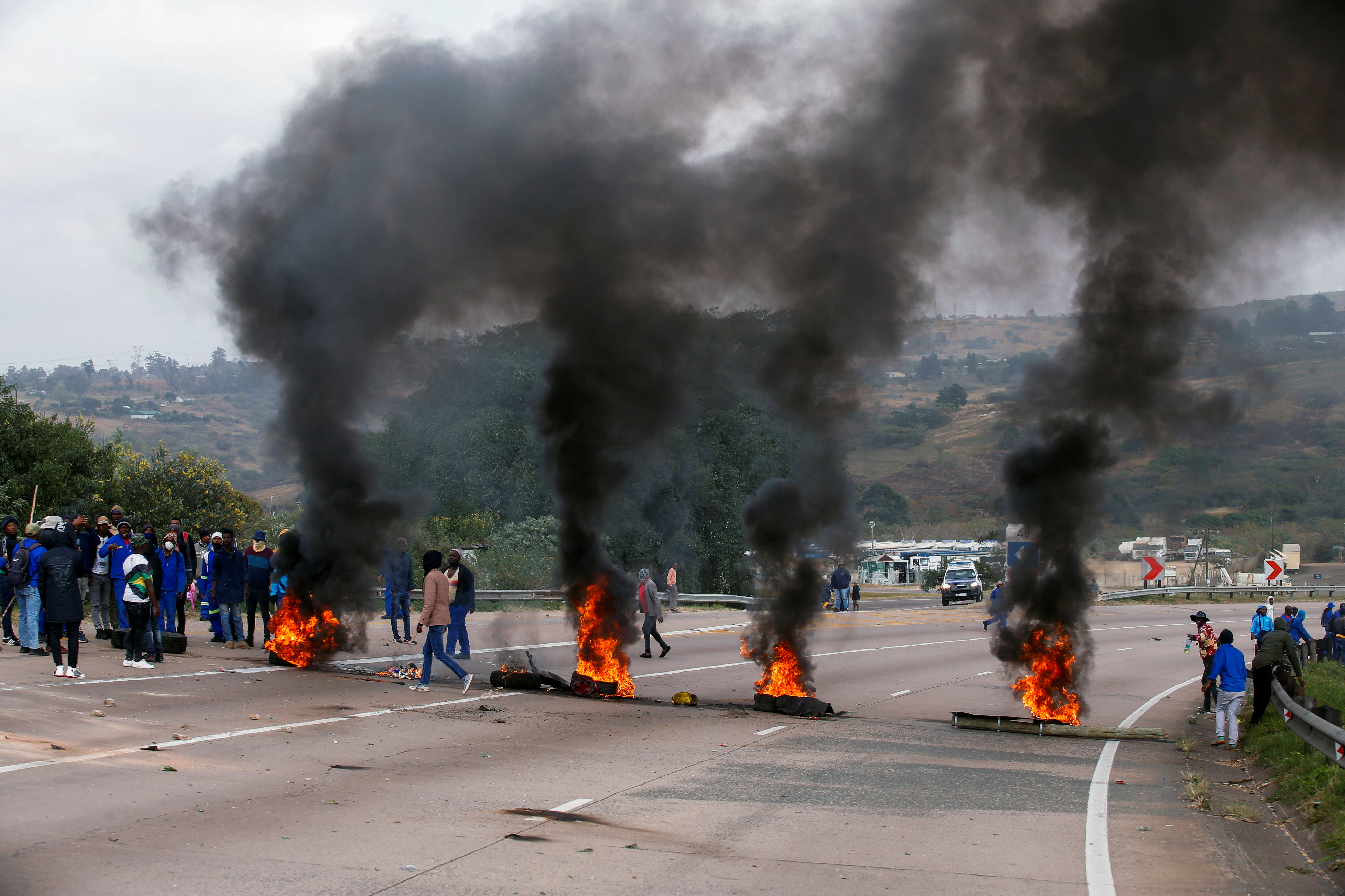 Supporters of former South African President Jacob Zuma block the freeway with burning tyres during a protest in Peacevale, South Africa, July 9, 2021. REUTERS/Rogan Ward/File Photo