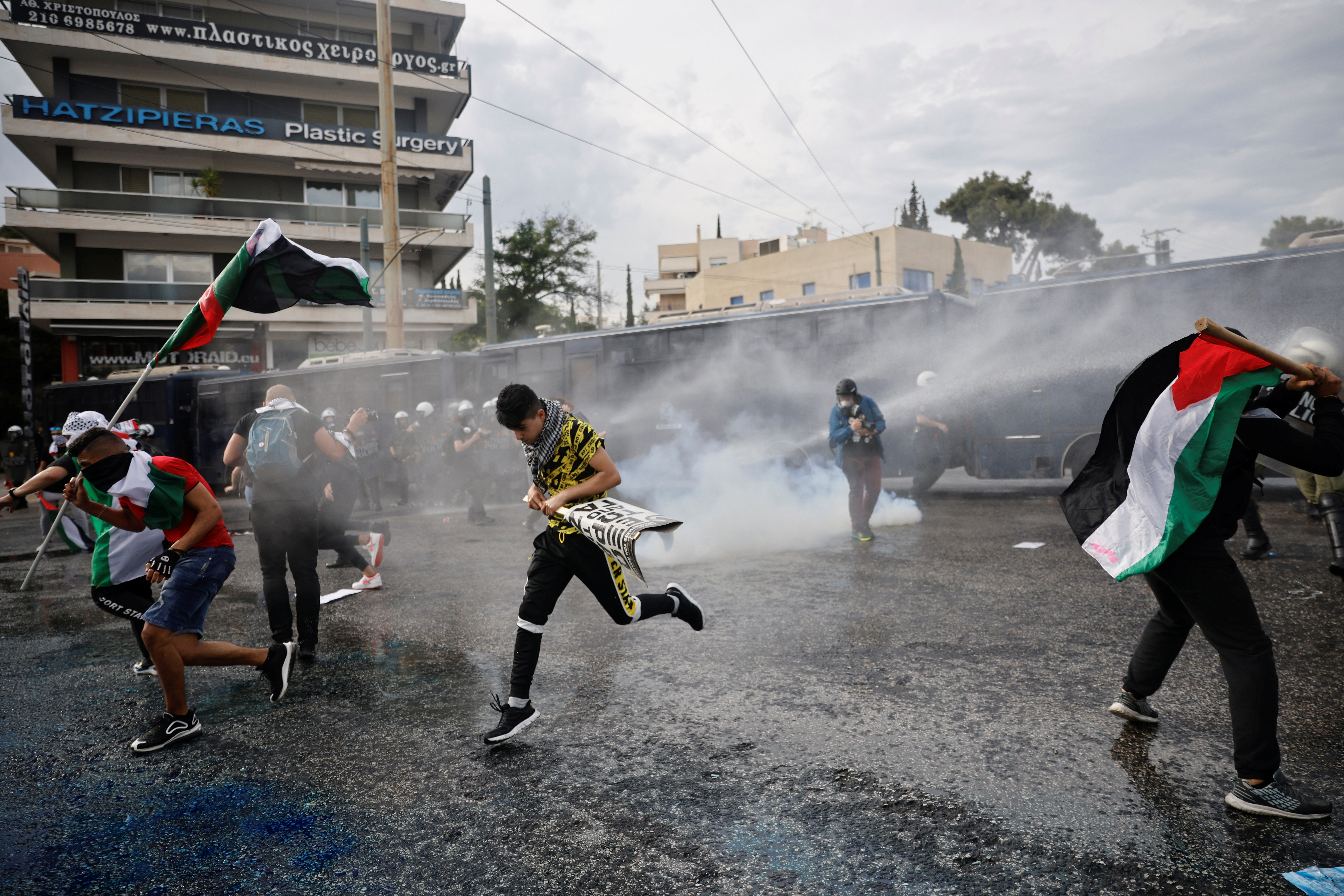 Police officers use a water cannon against pro-Palestinian protesters as they clash during a demonstration outside the Israeli embassy, following a flare-up of Israeli-Palestinian violence, in Athens, Greece, May 15, 2021. REUTERS/Alkis Konstantinidis