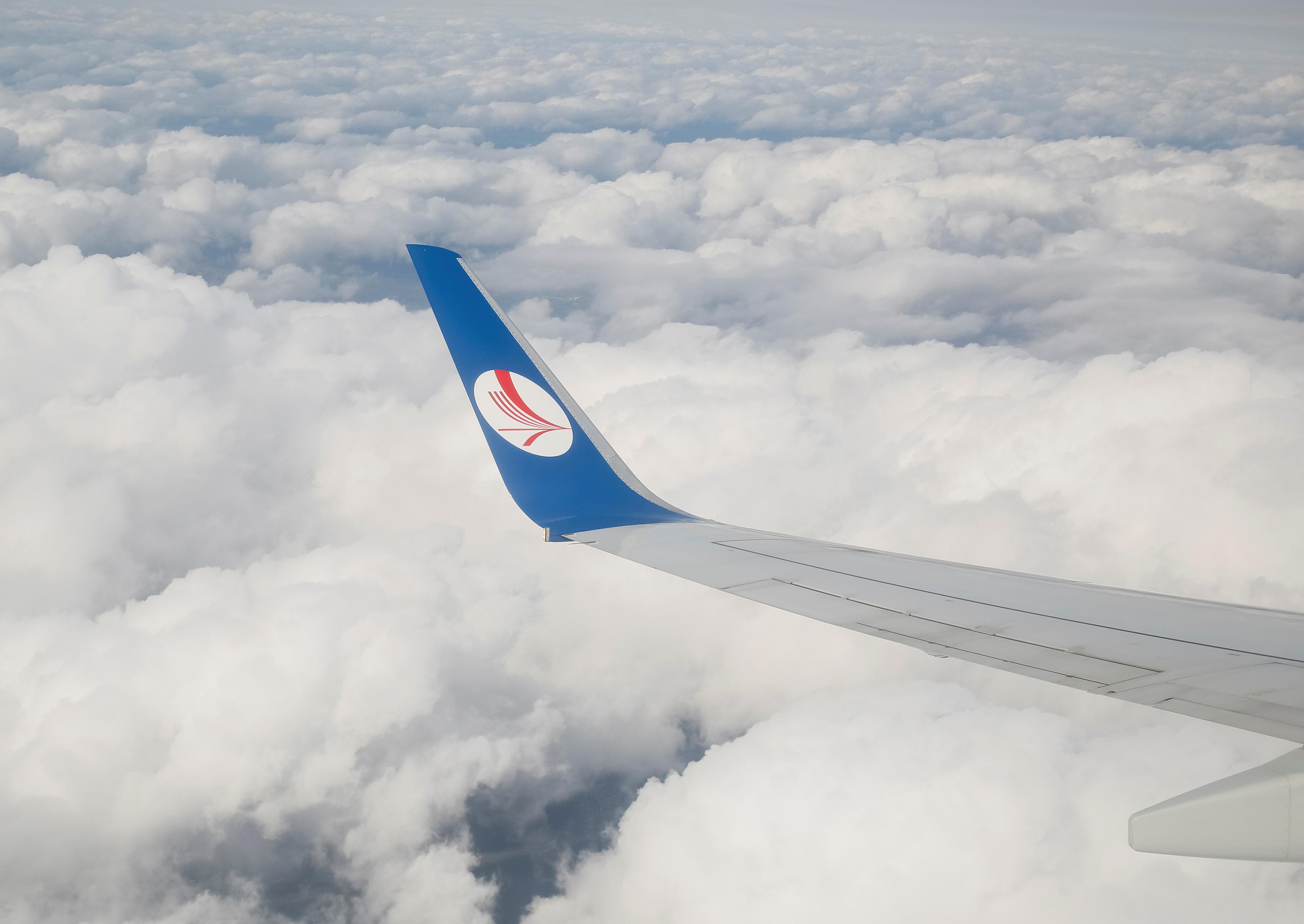 A wing of a plane of Belavia company is seen over clouds near Minsk, Belarus, July 19, 2016.  REUTERS/Gleb Garanich
