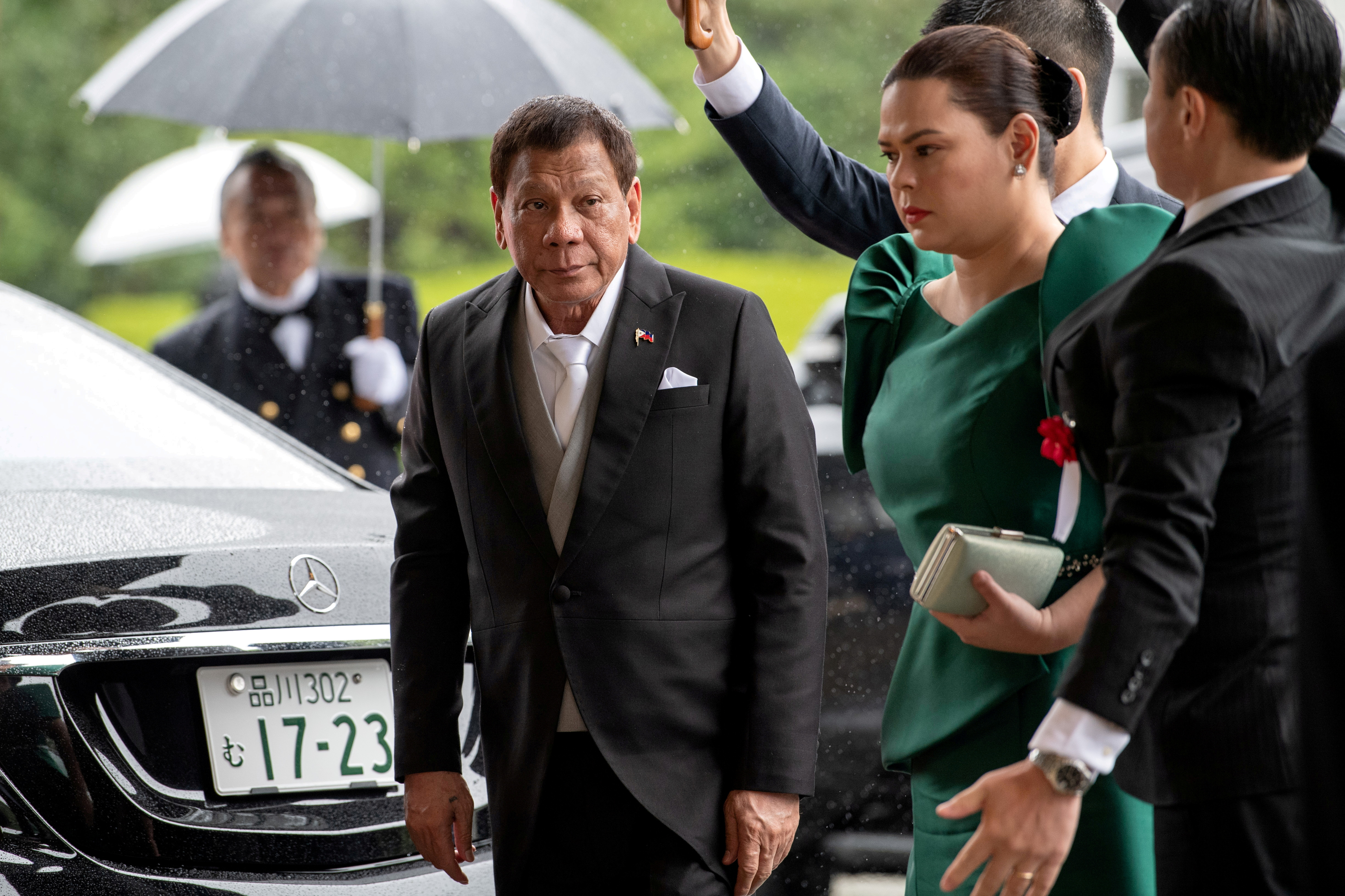 Philippines President Rodrigo Duterte arrives with daughter Sara Duterte-Carpio to attend the enthronement ceremony of Japan's Emperor Naruhito in Tokyo, Japan October 22, 2019.  Carl Court/Pool via REUTERS/File Photo