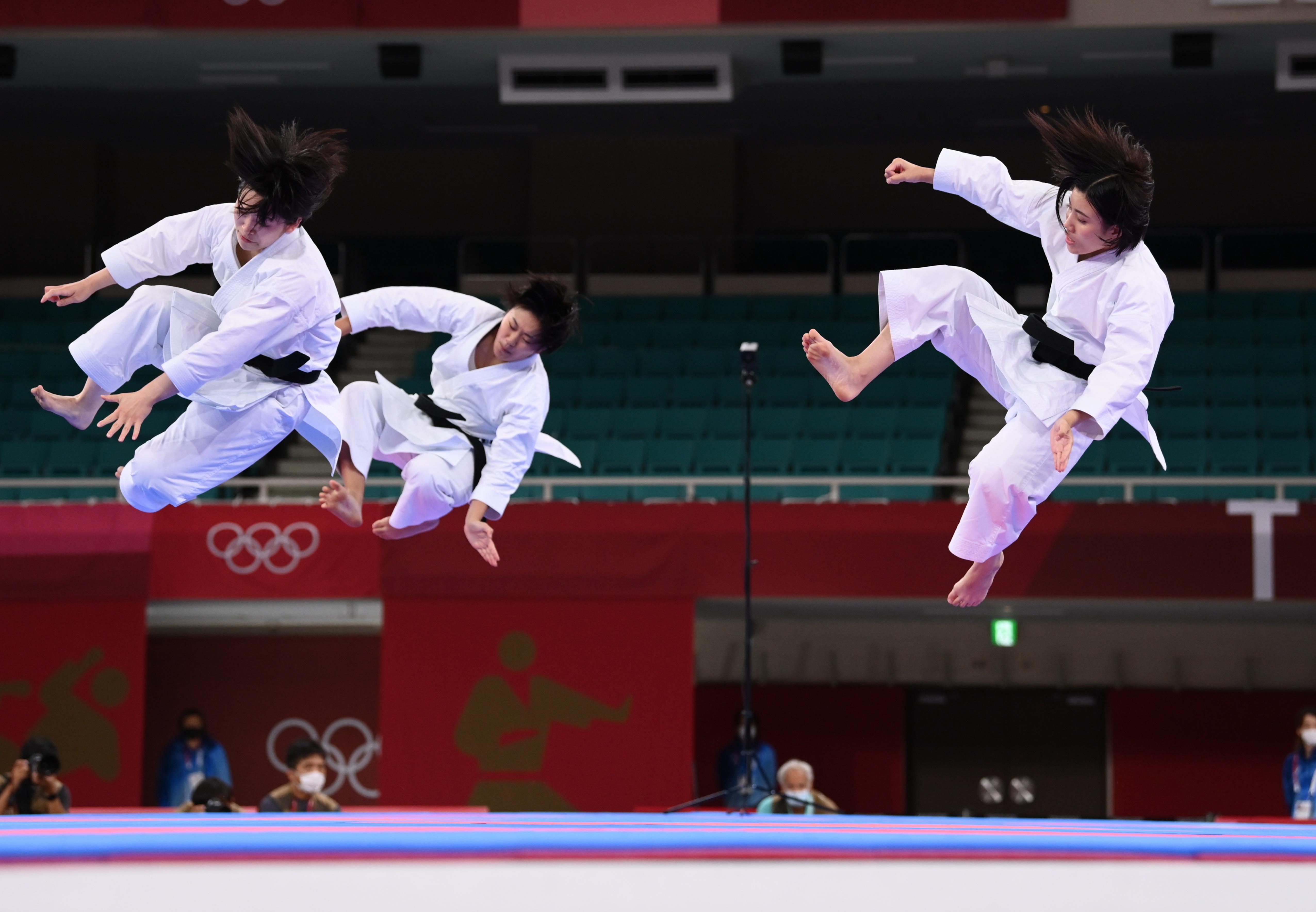 Tokyo 2020 Olympics - Karate - Team Japan's team kata performance - Nippon Budokan, Tokyo, Japan - August 6, 2021. Members of Japan's national team perform. REUTERS/Annegret Hilse - SP1EH860A8JPX