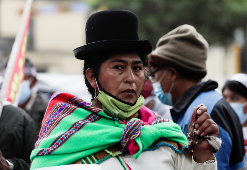 Supporters of Peru's presidential candidate Pedro Castillo gather outside the headquarters of the