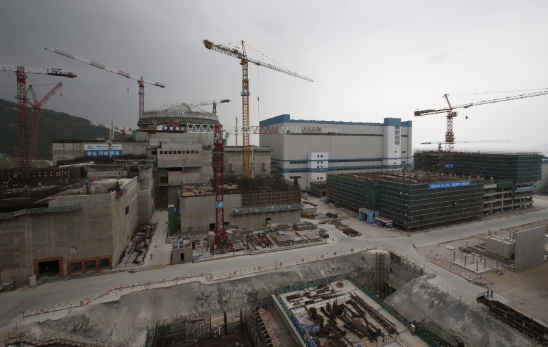 A nuclear reactor and related factilities as part of the Taishan Nuclear Power Plant, to be operated by China Guangdong Nuclear Power (CGN), is seen under construction in Taishan, Guangdong province, October 17, 2013. As China signs global deals to export its nuclear power technology, it faces a huge obstacle: it still needs to show it can build and safely operate these reactors at home. Aided by foreign technology acquired during three decades of development, China has the highest number of reactors being built and ambitions to export its home-grown models to an overseas market worth hundreds of billions of dollars. Picture taken October 17, 2013.  REUTERS/Bobby Yip   (CHINA - Tags: ENERGY ENVIRONMENT SCIENCE TECHNOLOGY BUSINESS)