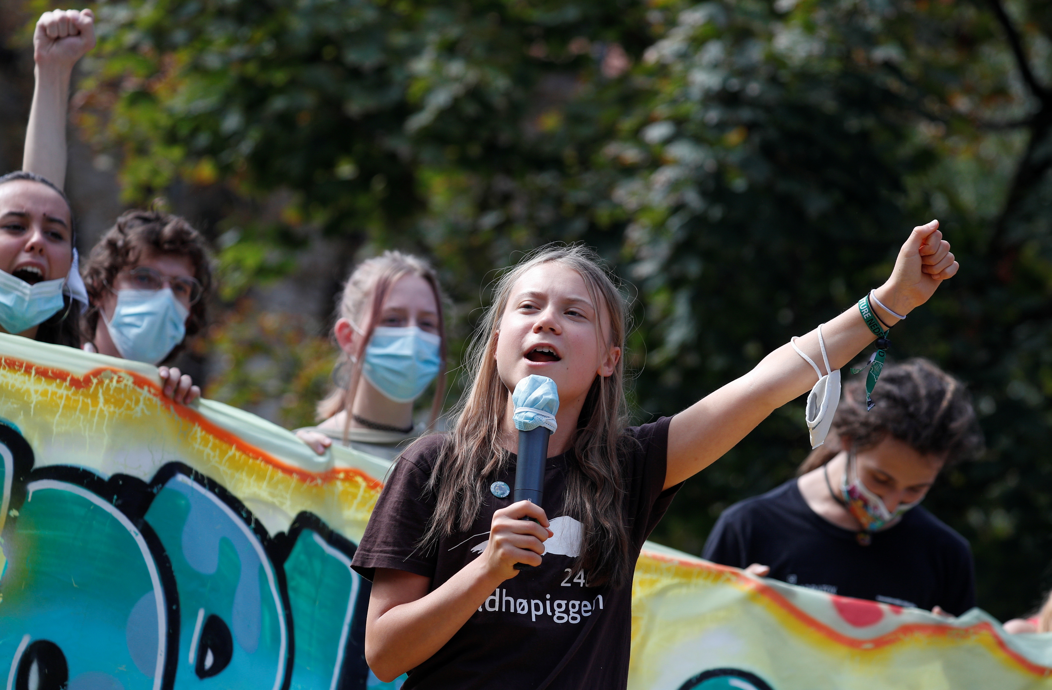 Climate activist Greta Thunberg speaks as she joins students holding a Fridays for Future climate strike while environment ministers meet ahead of Glasgow's COP26 meeting, in Milan, Italy, October 1, 2021.