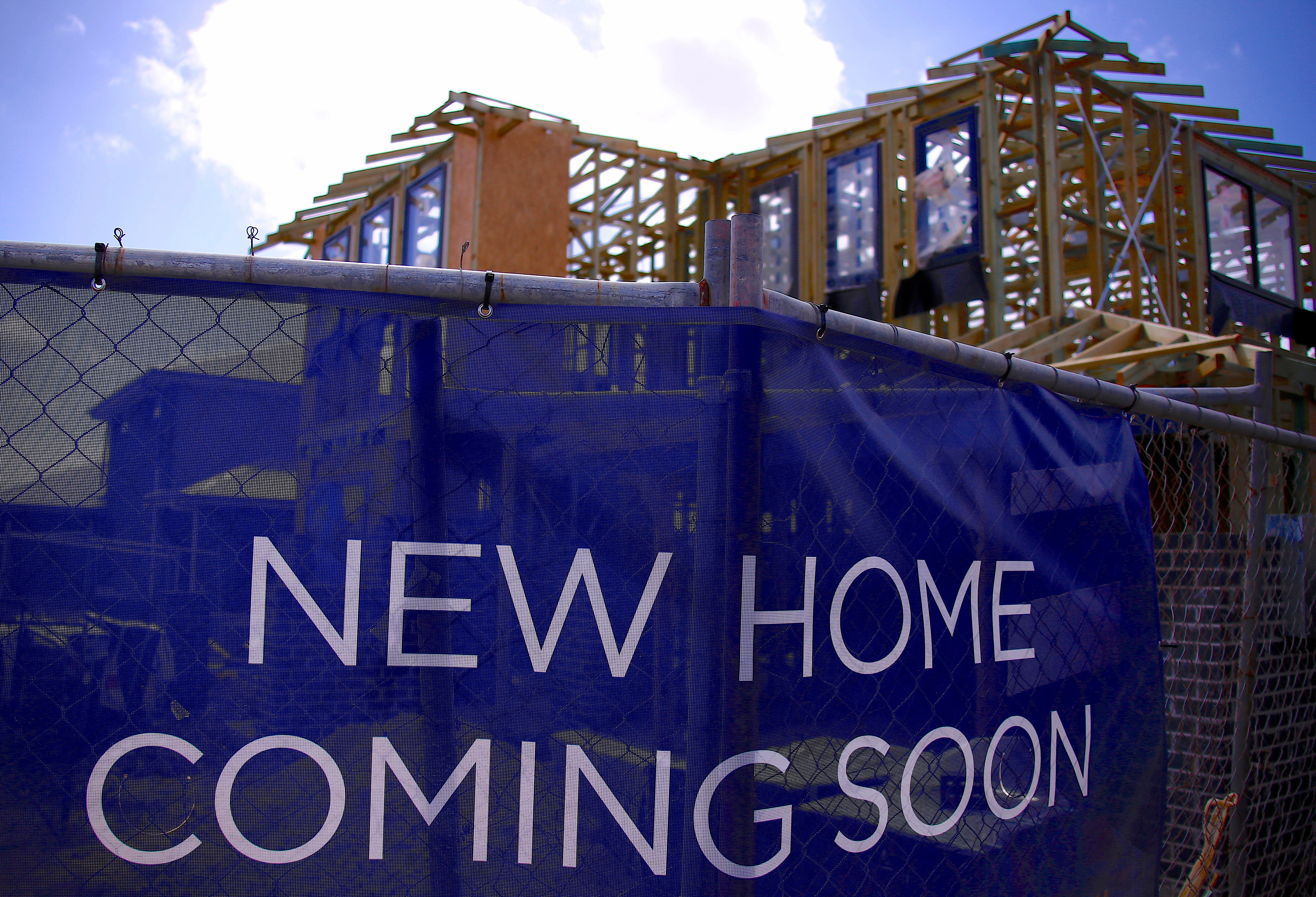 A house under construction can be seen behind an advertising banner at a housing development located in the western Sydney suburb of Oran Park in Australia, October 21, 2017. REUTERS/David Gray