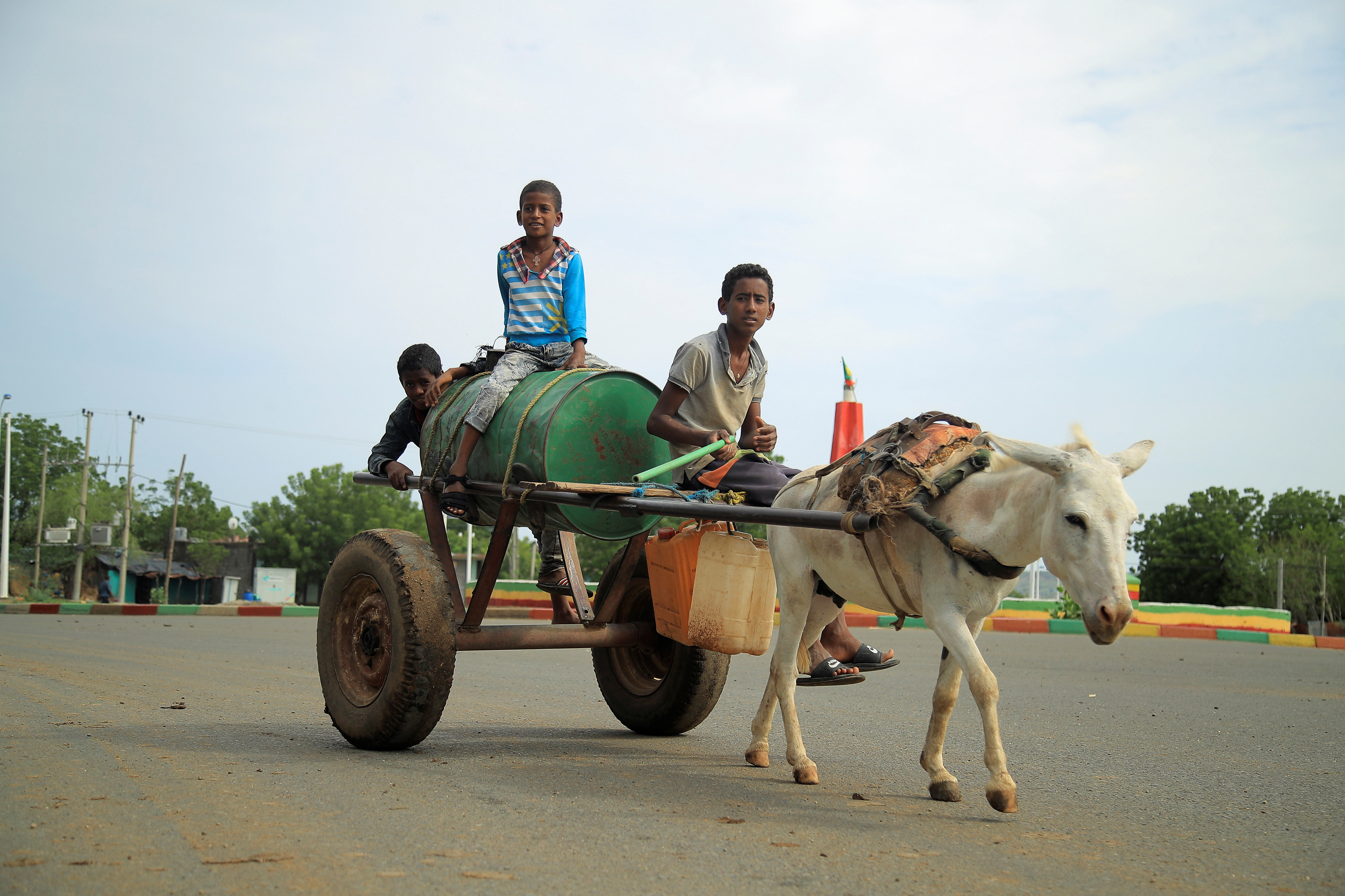 Civilians ride a cart along a street in Humera town, Ethiopia July 1, 2021. Picture taken July 1, 2021. REUTERS/Stringer