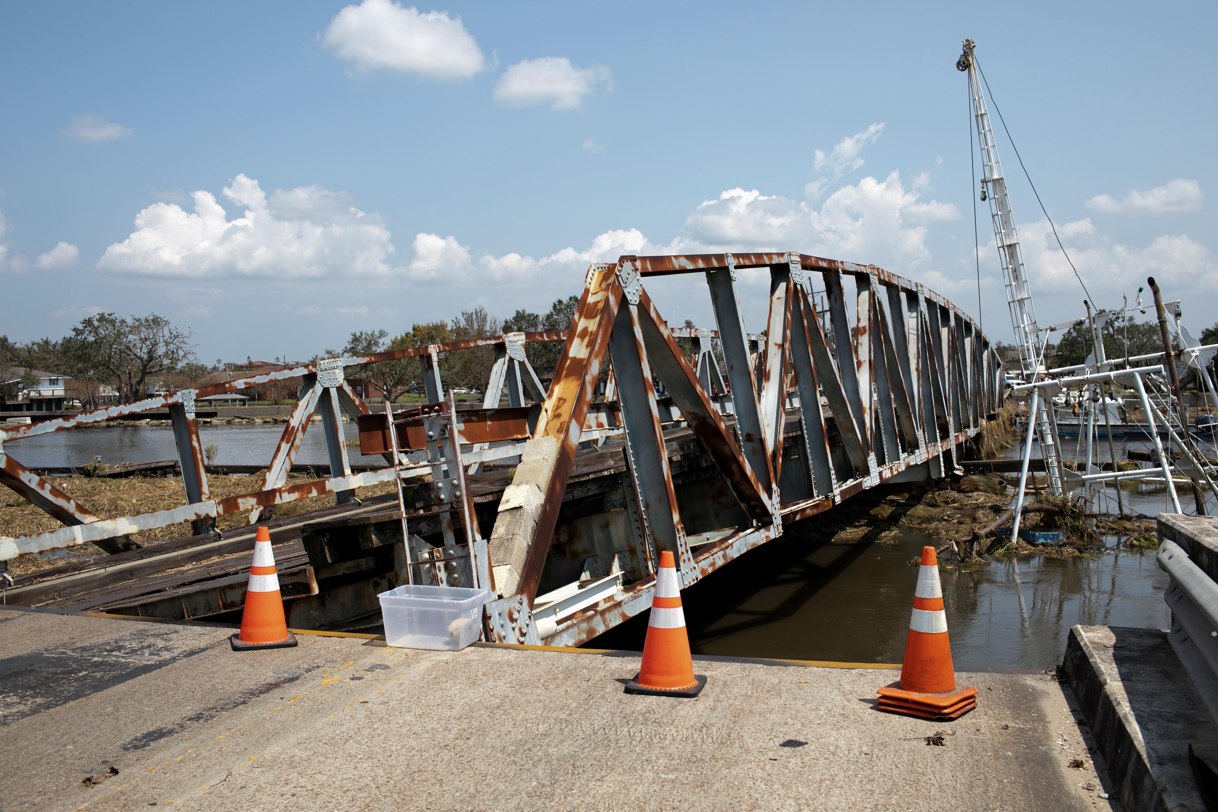 A damaged bridge is seen in the aftermath of Hurricane Ida landfall in Louisiana, in Jean Lafitte, Louisiana, U.S. September 2, 2021. REUTERS/Marco Bello