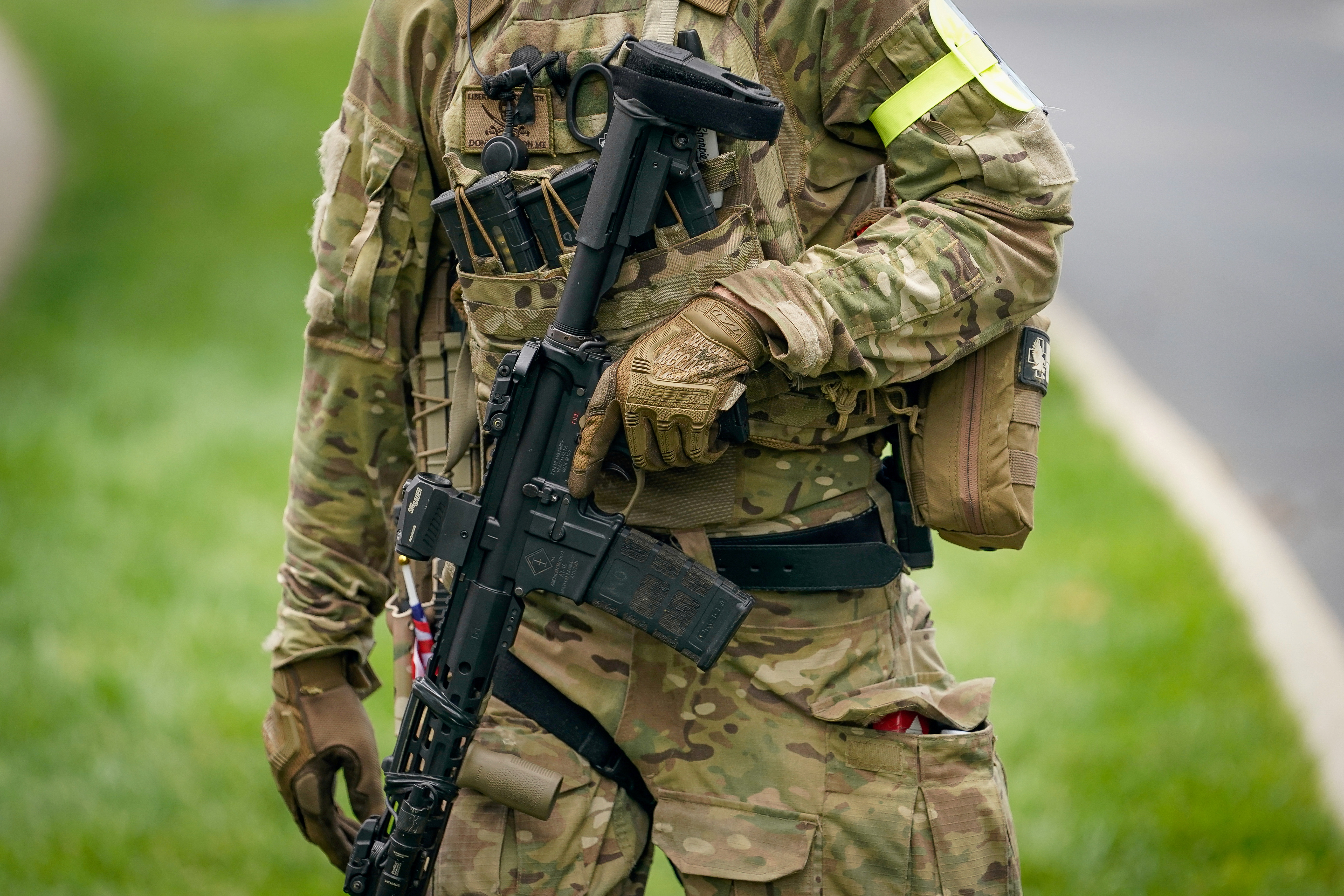 A member with the Three Percent Militia provides security for a