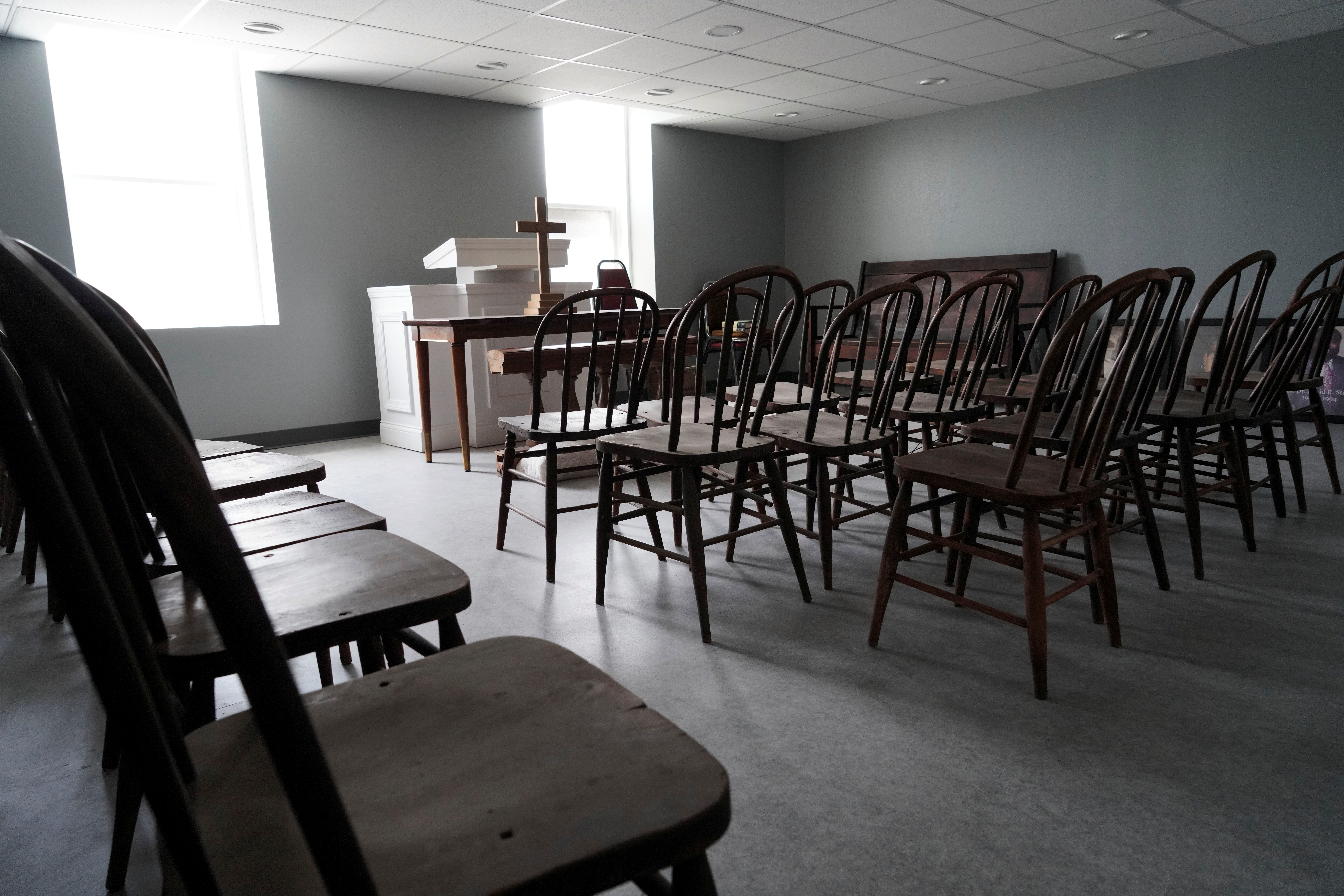 An altar and chairs, which were located in the basement of the original Vernon AME Church and the only part of the building to survive the 1921 Tulsa Massacre, sit in an empty prayer room in Vernon AME Church in Tulsa, Oklahoma, U.S., May 30, 2021. REUTERS/Lawrence Bryant