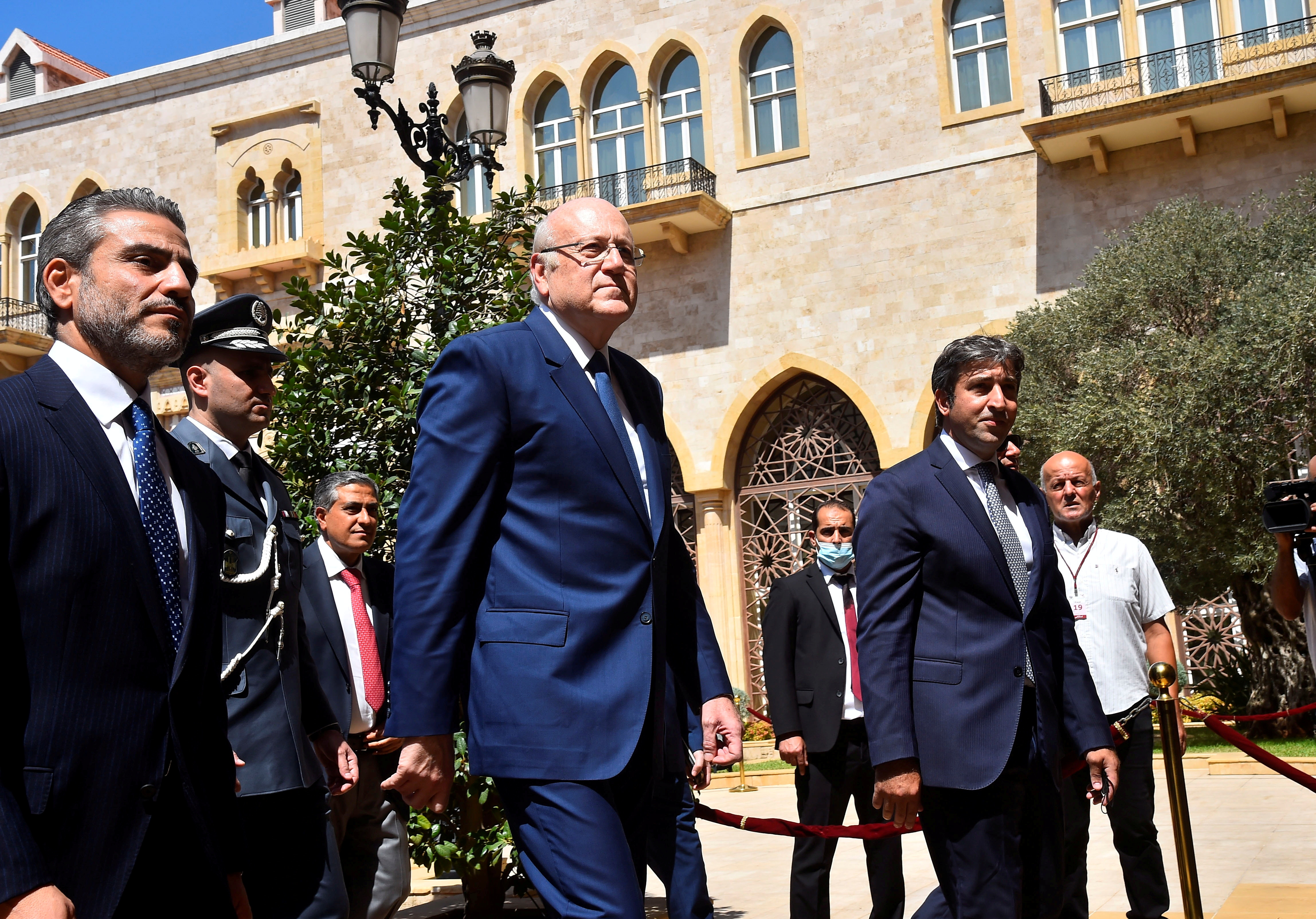 Lebanon's new Prime Minister Najib Mikati walks during an official ceremony to mark his assumption of duties at the Government Palace in Beirut, Lebanon September 13, 2021. Dalati Nohra/Handout via REUTERS