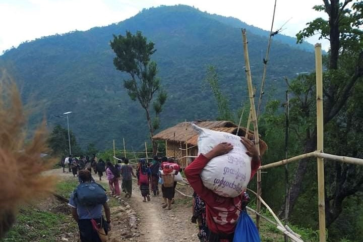 People displaced by fighting in north-western Myanmar between junta forces and anti-junta fighters walk in Chin State, Myanmar, May 31, 2021. REUTERS/Stringer