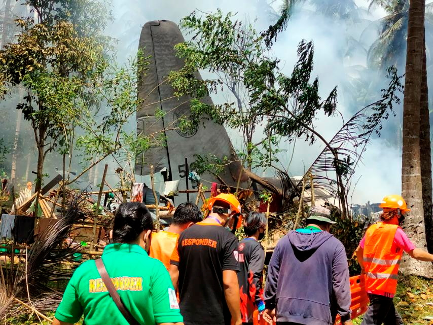 First responders work at the site after a Philippines Air Force Lockheed C-130 plane carrying troops crashed on landing in Patikul, Sulu province, Philippines July 4, 2021. Armed Forces of the Philippines - Joint Task Force Sulu/Handout via REUTERS
