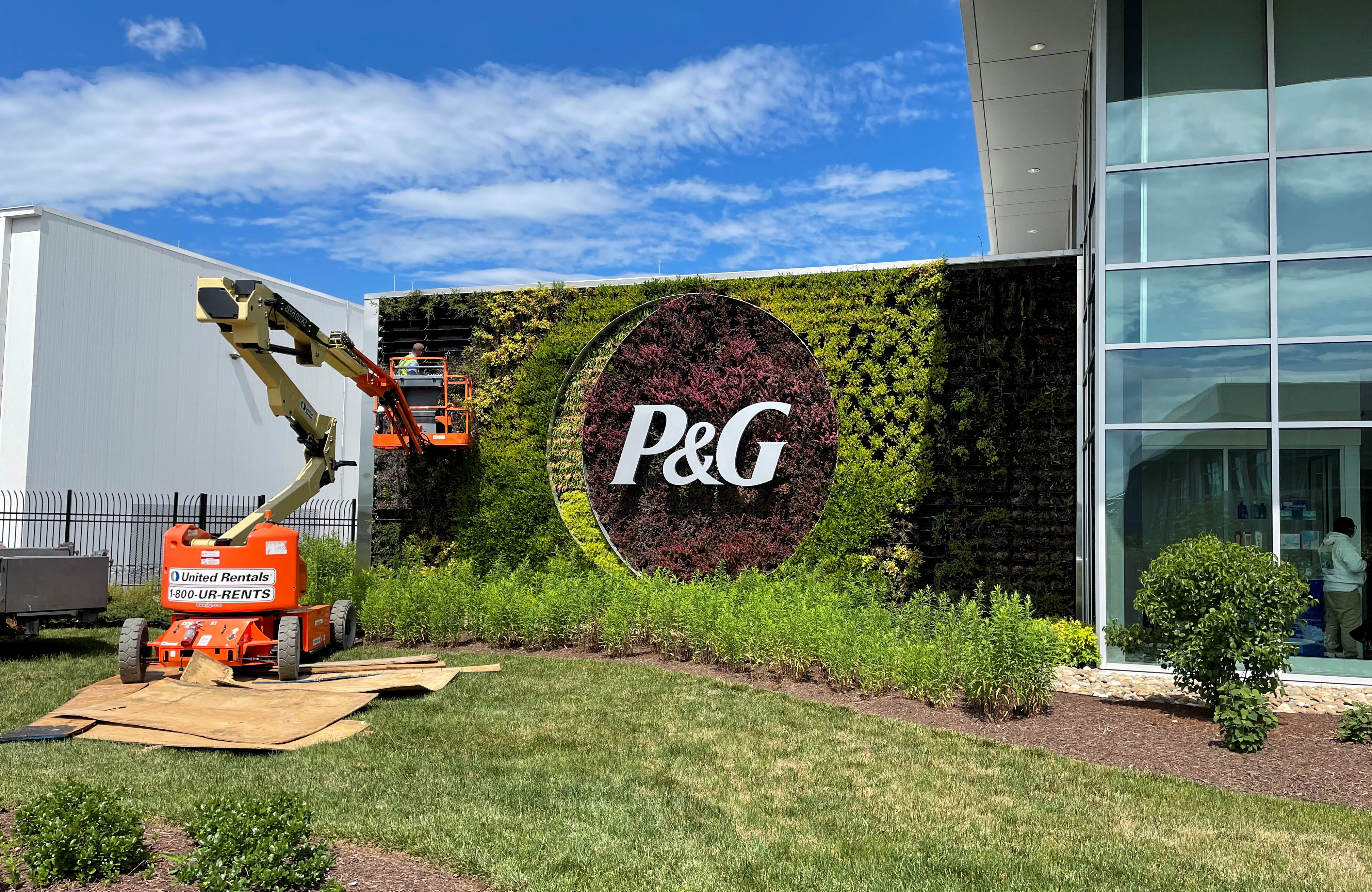 A plant wall with Procter & Gamble's logo is pictured at the entrance to the company's highly automated cleaning products factory in Tabler Station, West Virginia, U.S., May 28, 2021. Picture taken May 28, 2021. REUTERS/Timothy Aeppel