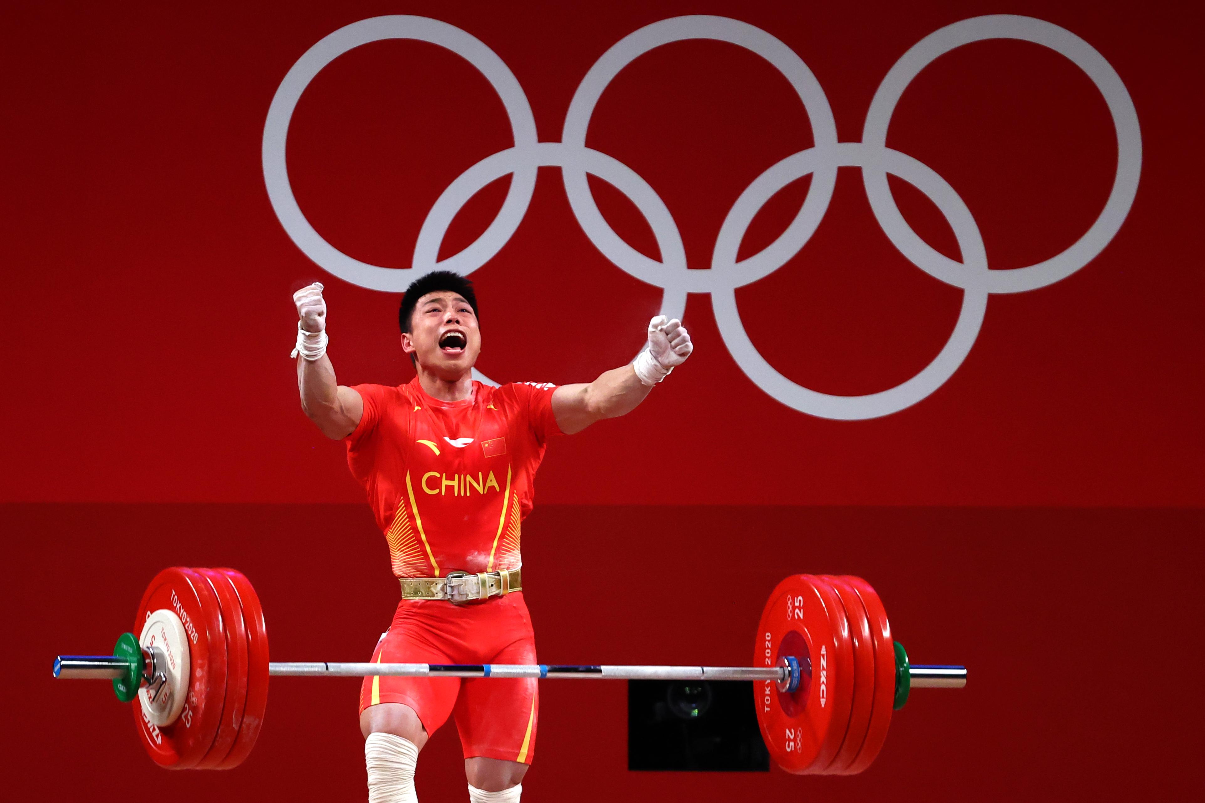 Tokyo 2020 Olympics - Weightlifting - Men's 67kg - Group A - Tokyo International Forum, Tokyo, Japan - July 25, 2021. Chen Lijun of China celebrates after a lift. REUTERS/Edgard Garrido