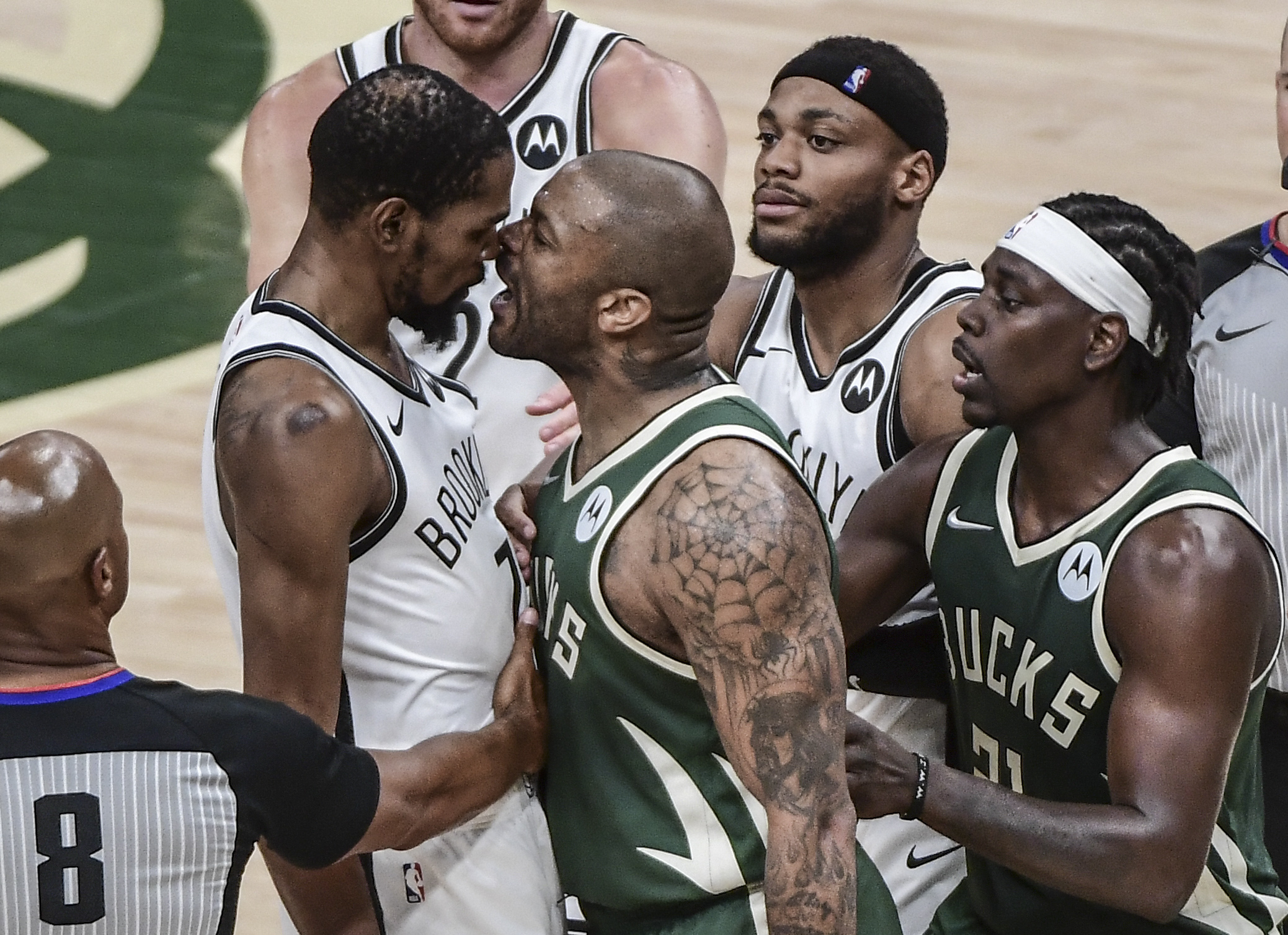 Jun 10, 2021; Milwaukee, Wisconsin, USA; Milwaukee Bucks forward P.J. Tucker (17) yells in the face of Brooklyn Nets forward Kevin Durant (7) in the third quarter during game three in the second round of the 2021 NBA Playoffs at Fiserv Forum. Mandatory Credit: Benny Sieu-USA TODAY Sports