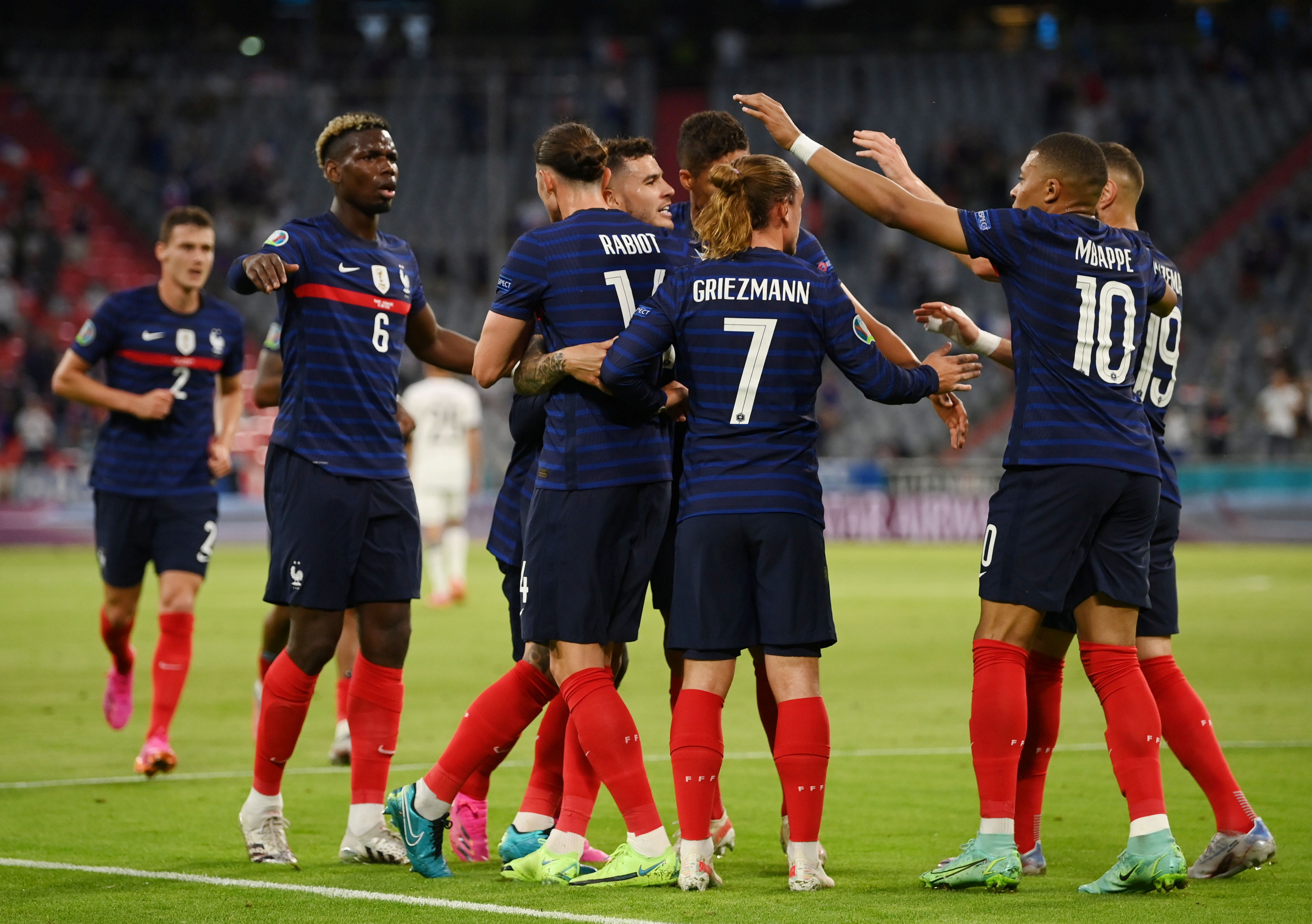 Soccer Football - Euro 2020 - Group F - France v Germany - Football Arena Munich, Munich, Germany - June 15, 2021 France's players celebrate after Germany's Mats Hummels scores an own goal and the first for France Pool via REUTERS/Matthias Hangst
