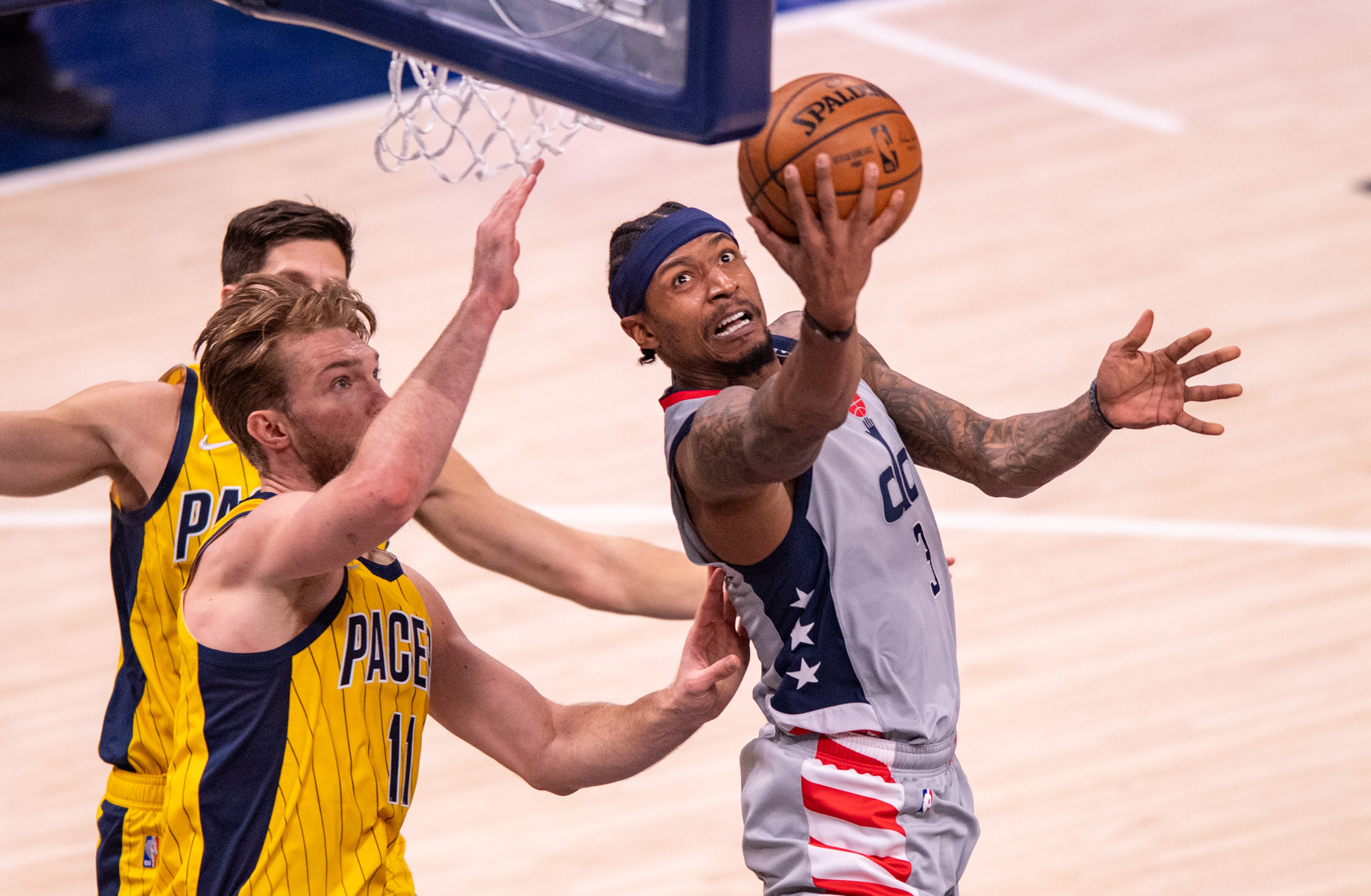 May 8, 2021; Indianapolis, Indiana, USA; Washington Wizards guard Bradley Beal (3) scores with a reverse layup during the second half against the Indiana Pacers at Bankers Life Fieldhouse. Mandatory Credit: Doug McSchooler-USA TODAY Sports