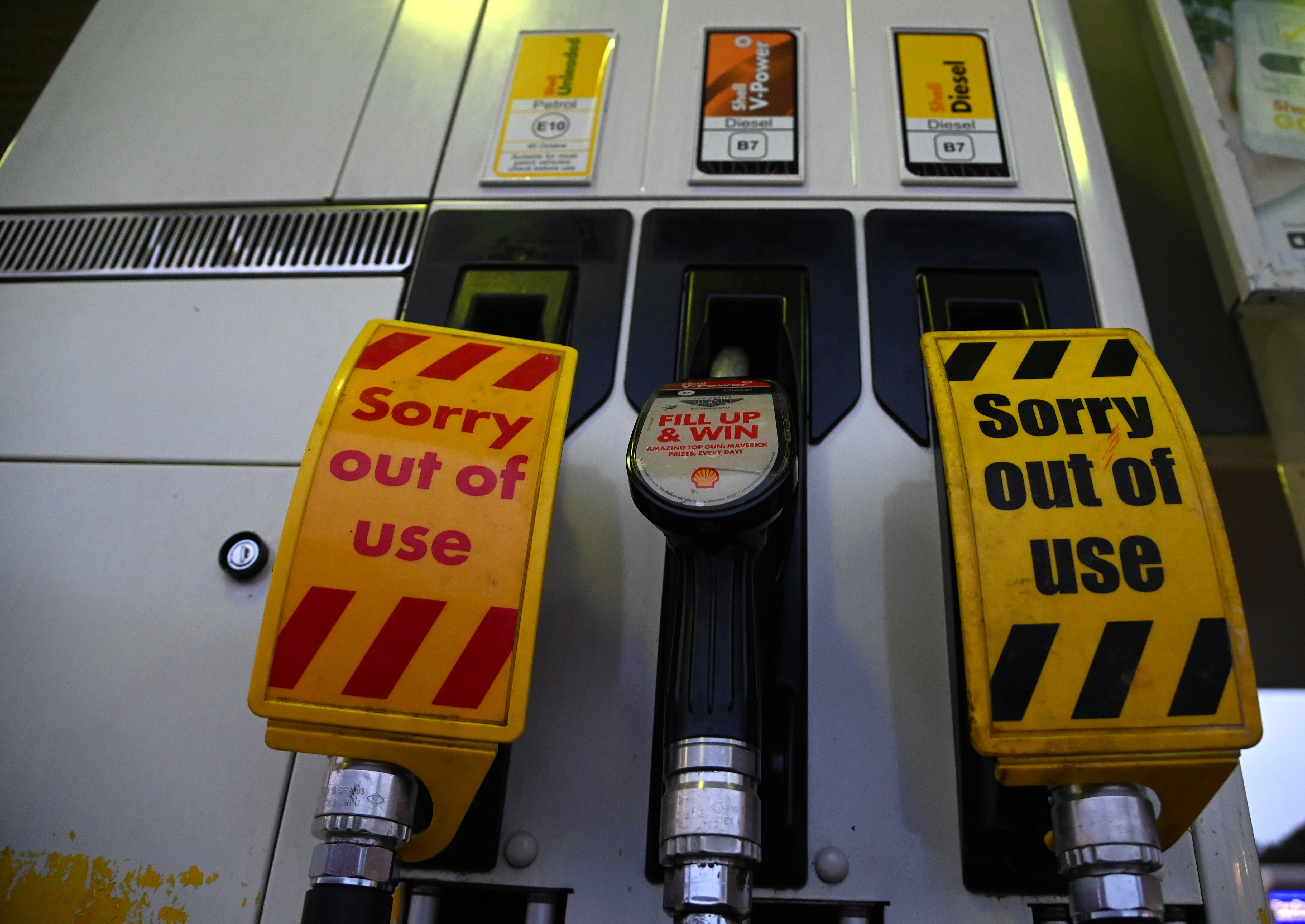 Out of use signs are placed over pumps at a Shell petrol station in London, Britain, September 24, 2021. REUTERS/Toby Melville