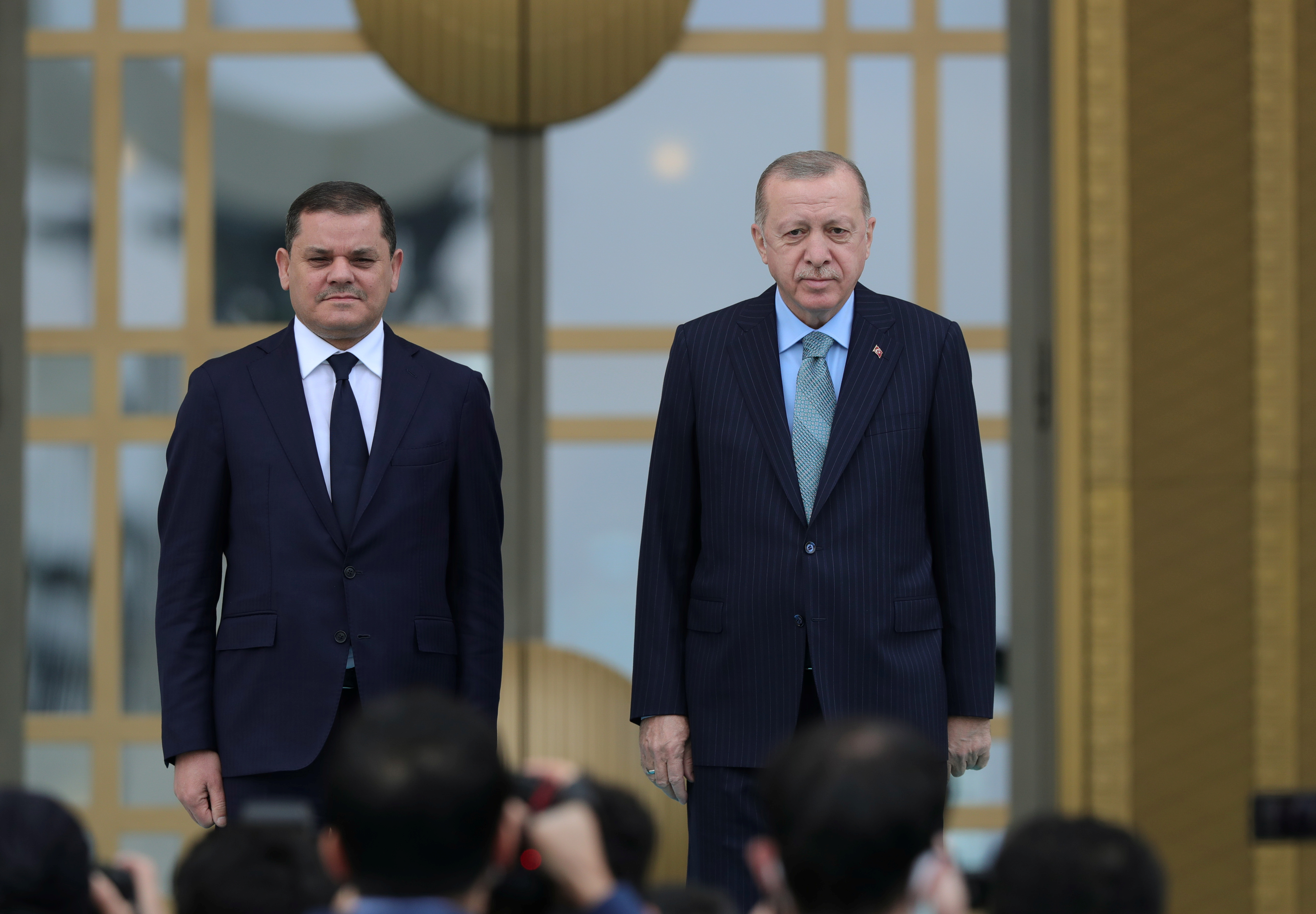 Turkish President Tayyip Erdogan and Libyan Prime Minister Abdulhamid?Dbeibeh attend a welcoming ceremony at the Presidential Palace?in Ankara, Turkey April 12, 2021. Presidential Press Office/Handout via REUTERS
