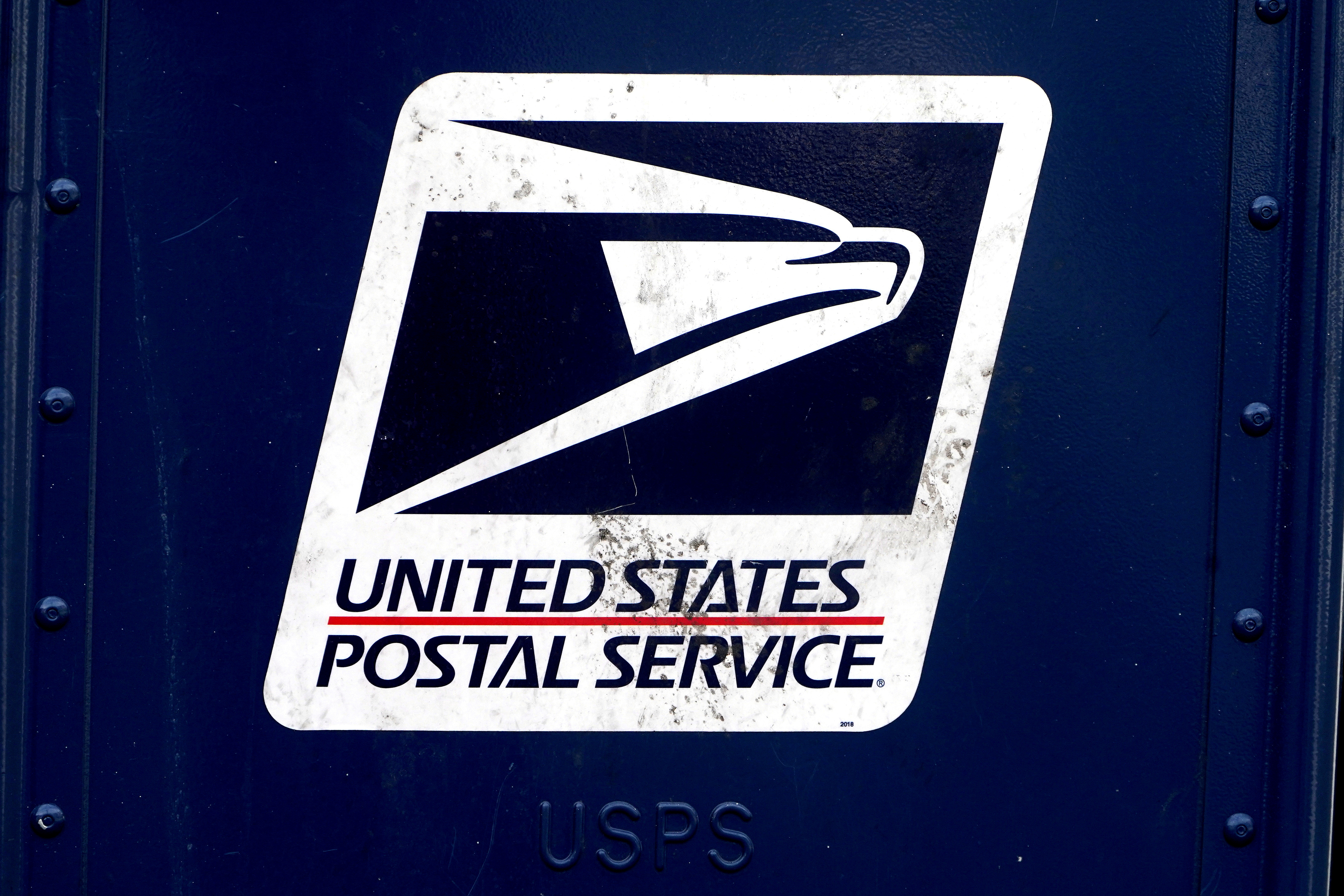 A U.S. Postal Service (USPS) logo is pictured on a mail box in the Manhattan borough of New York City, New York, U.S., August 21, 2020. REUTERS/Carlo Allegri