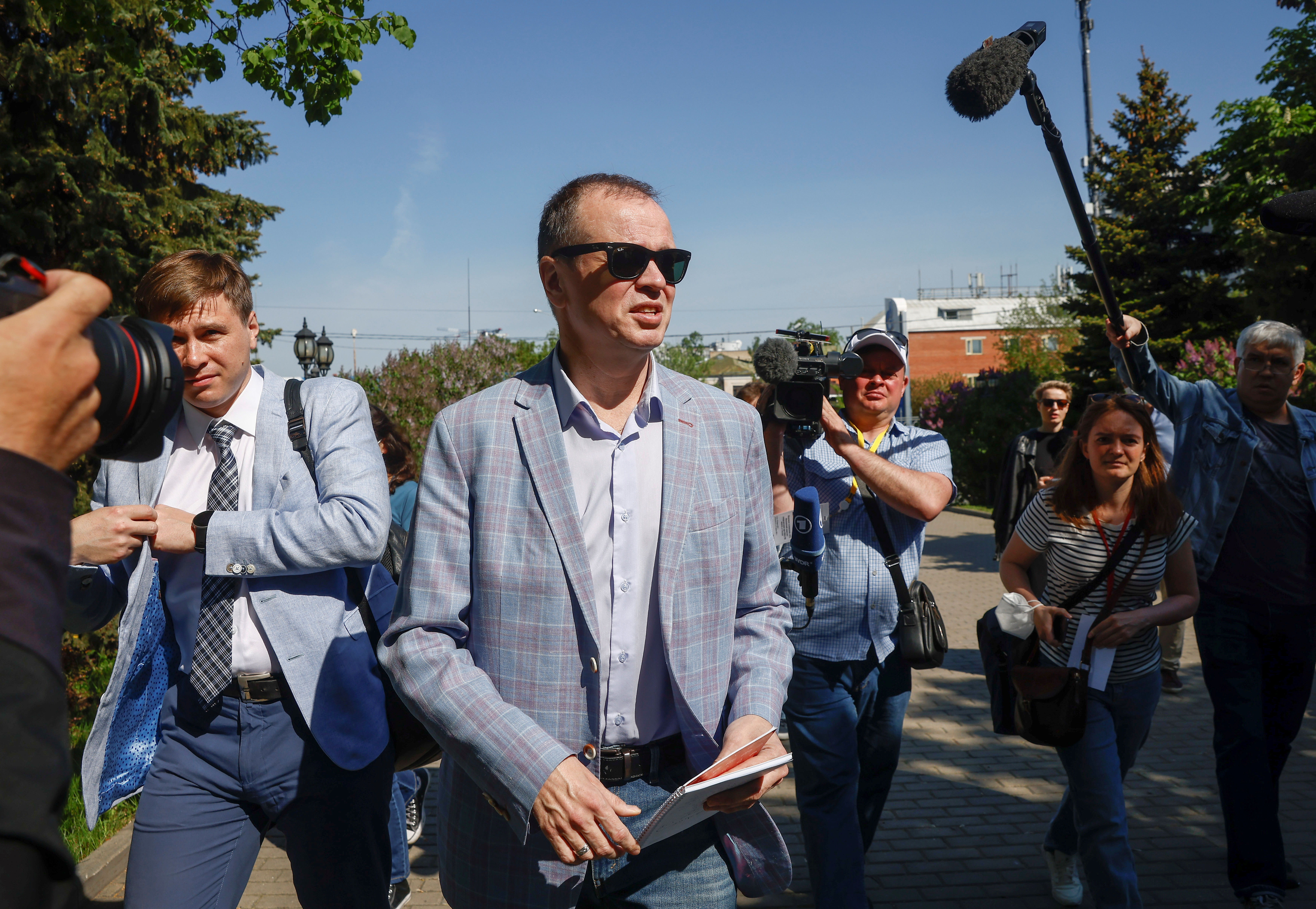 Ivan Pavlov, a lawyer defending Kremlin critic Alexei Navalny's Anti-Corruption Foundation (FBK) in an extremism case, speaks with journalists upon his arrival at a court building in Moscow, Russia May 17, 2021. REUTERS/Maxim Shemetov