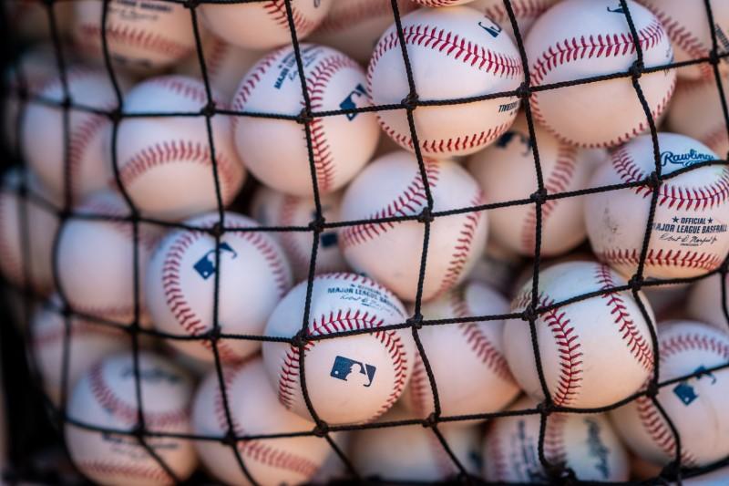 Jun 8, 2021; Oakland, California, USA;  A basket of baseballs await the Arizona Diamondbacks for warmups before the start of the game against the Oakland Athletics at RingCentral Coliseum. Mandatory Credit: Neville E. Guard-USA TODAY Sports