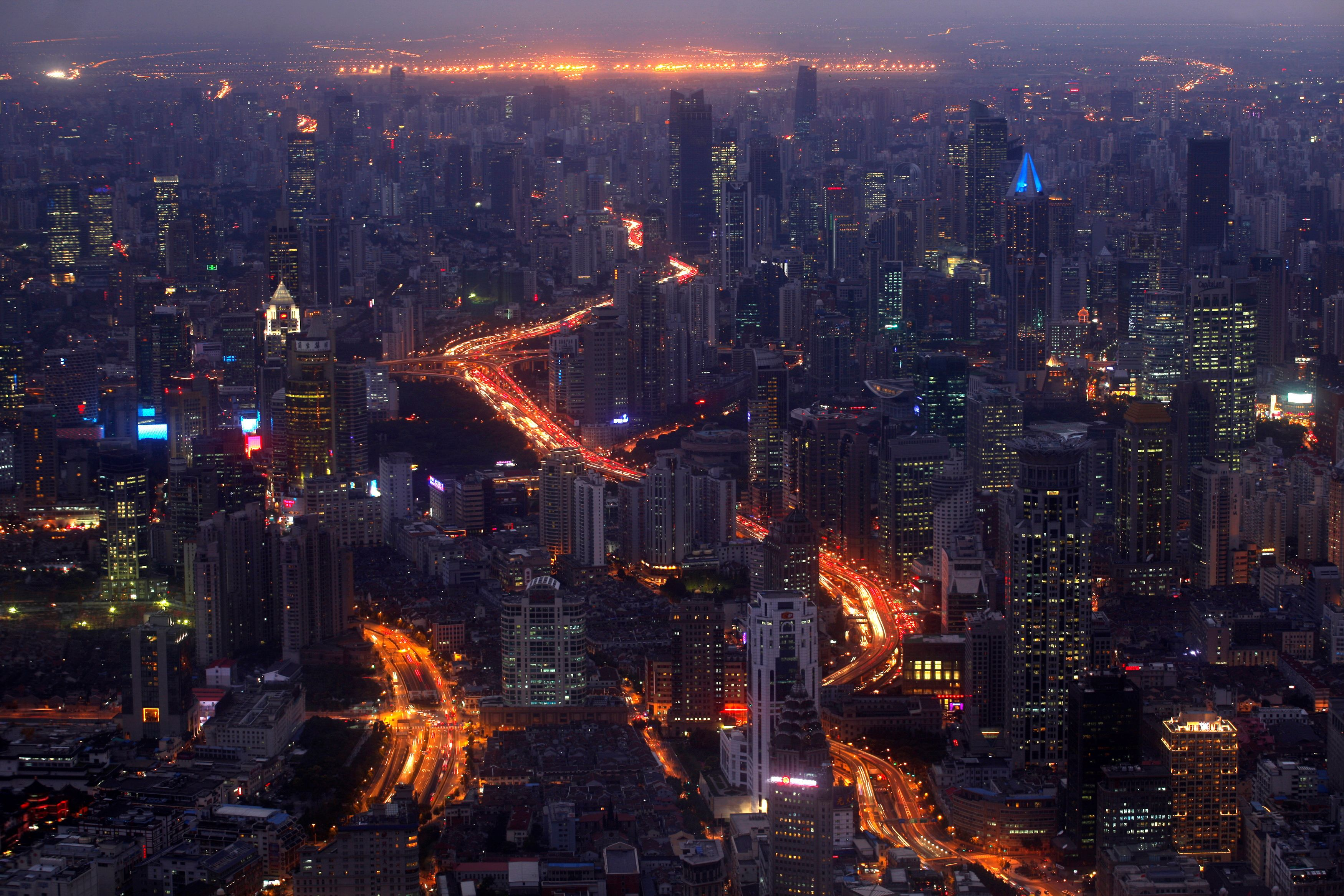 A view of the city skyline from the Shanghai Financial Center building, October 25, 2011. REUTERS/Carlos Barria