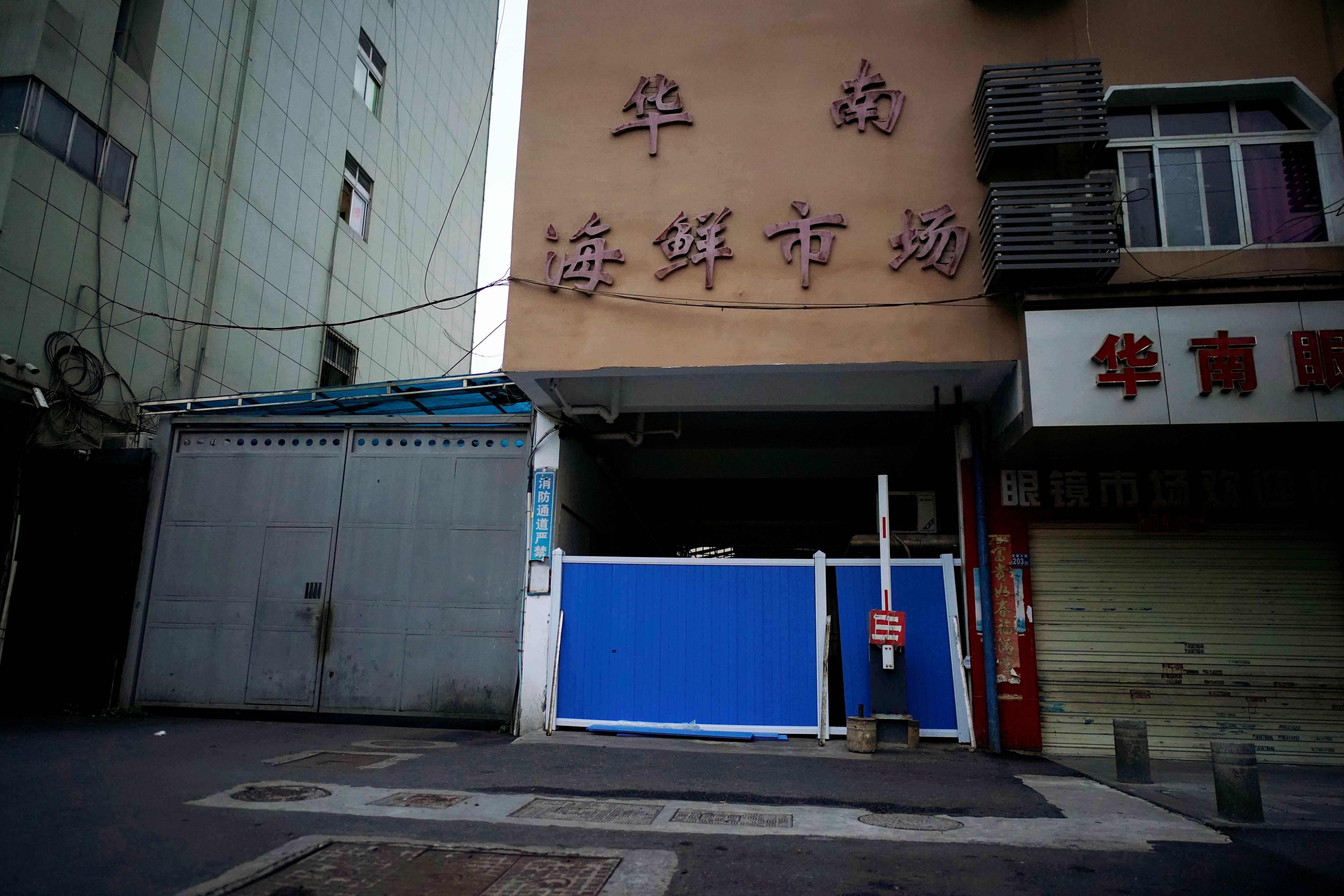 A blocked entrance to Huanan seafood market, where the coronavirus that can cause COVID-19 is believed to have first surfaced, is seen in Wuhan, Hubei province, China March 30, 2020. Picture taken March 30, 2020.  REUTERS/Aly Song/File Photo/File Photo