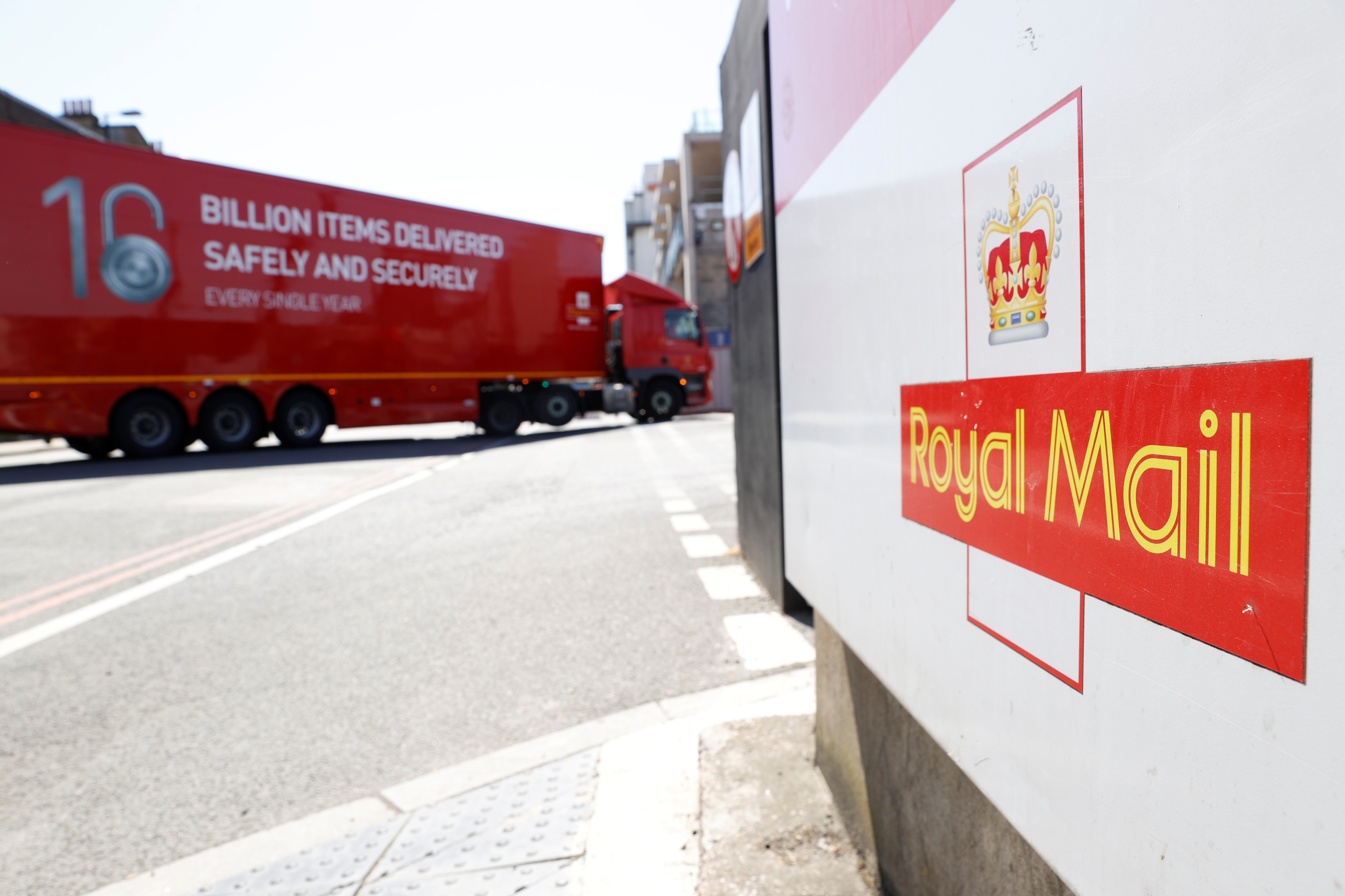 The logo of Royal Mail is seen outside the Mount Pleasant Sorting Office as a delivery vehicle arrives, in London, Britain, June 25, 2020. REUTERS/John Sibley