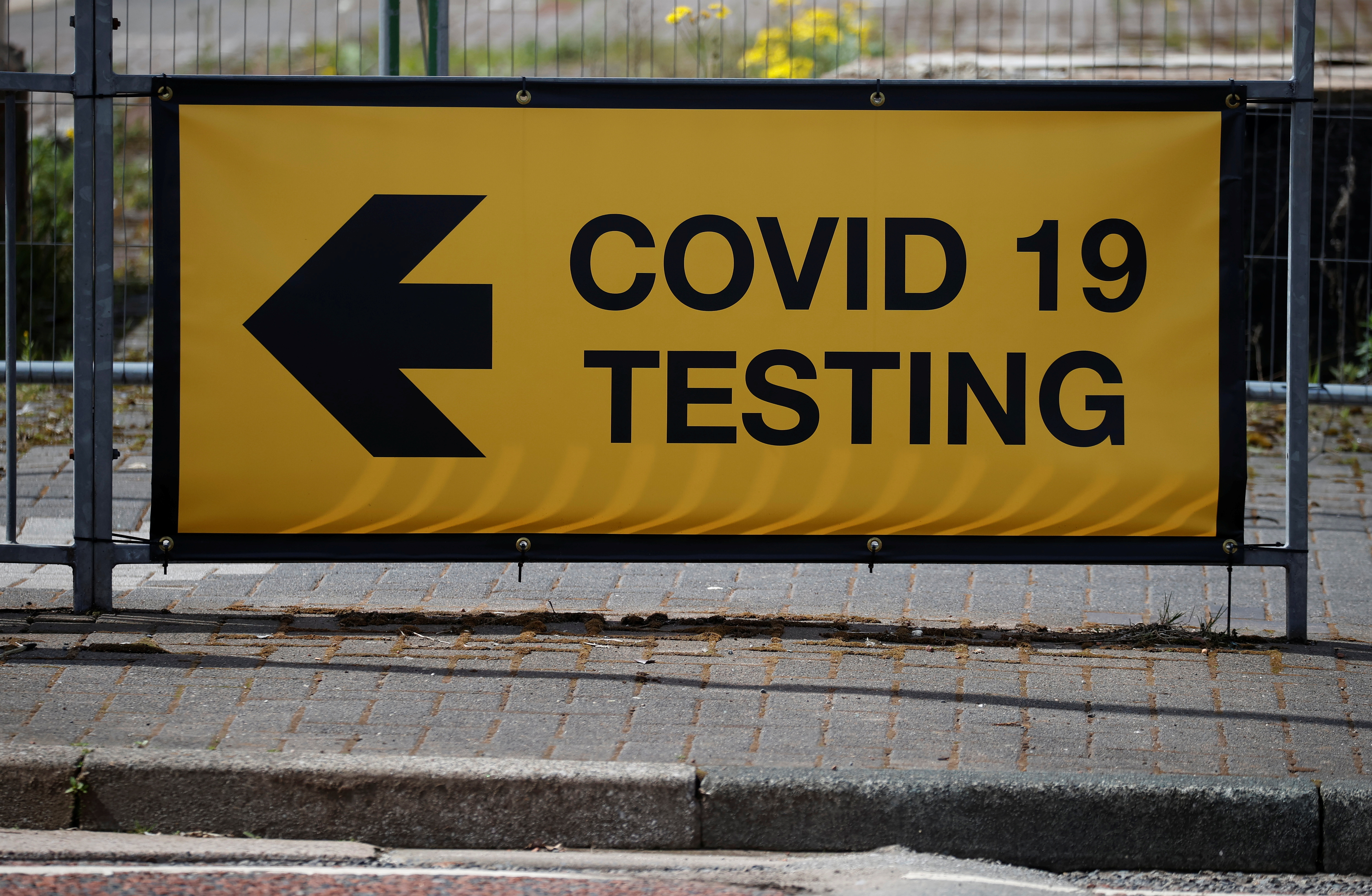 A sign directing people to a testing station, amid the outbreak of the coronavirus disease (COVID-19) in Bolton, Britain, May 16, 2021. REUTERS/Phil Noble