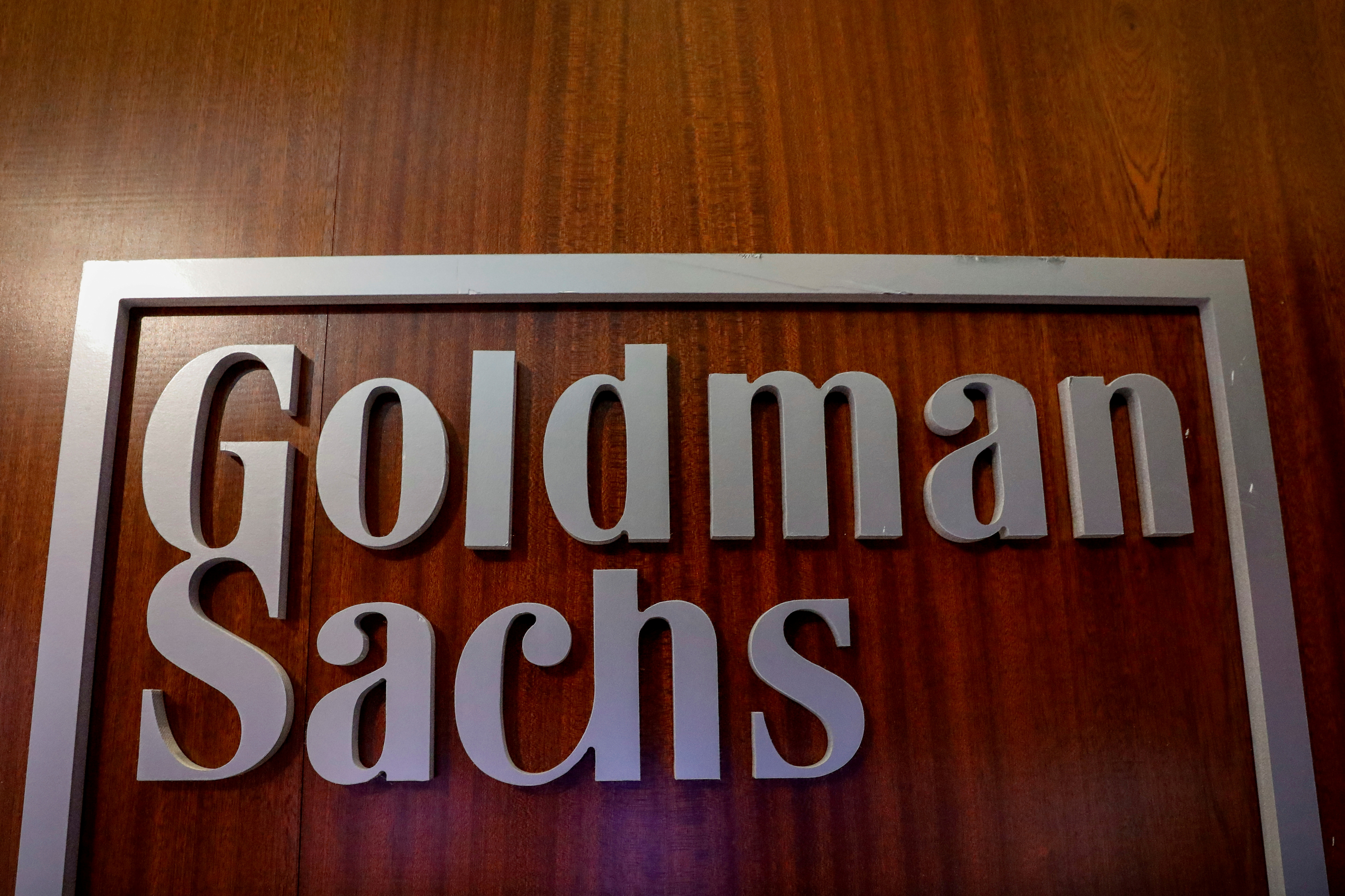The Goldman Sachs company logo is seen in the company's space on the floor of the New York Stock Exchange, (NYSE) in New York, U.S., April 17, 2018. REUTERS/Brendan McDermid/File Photo