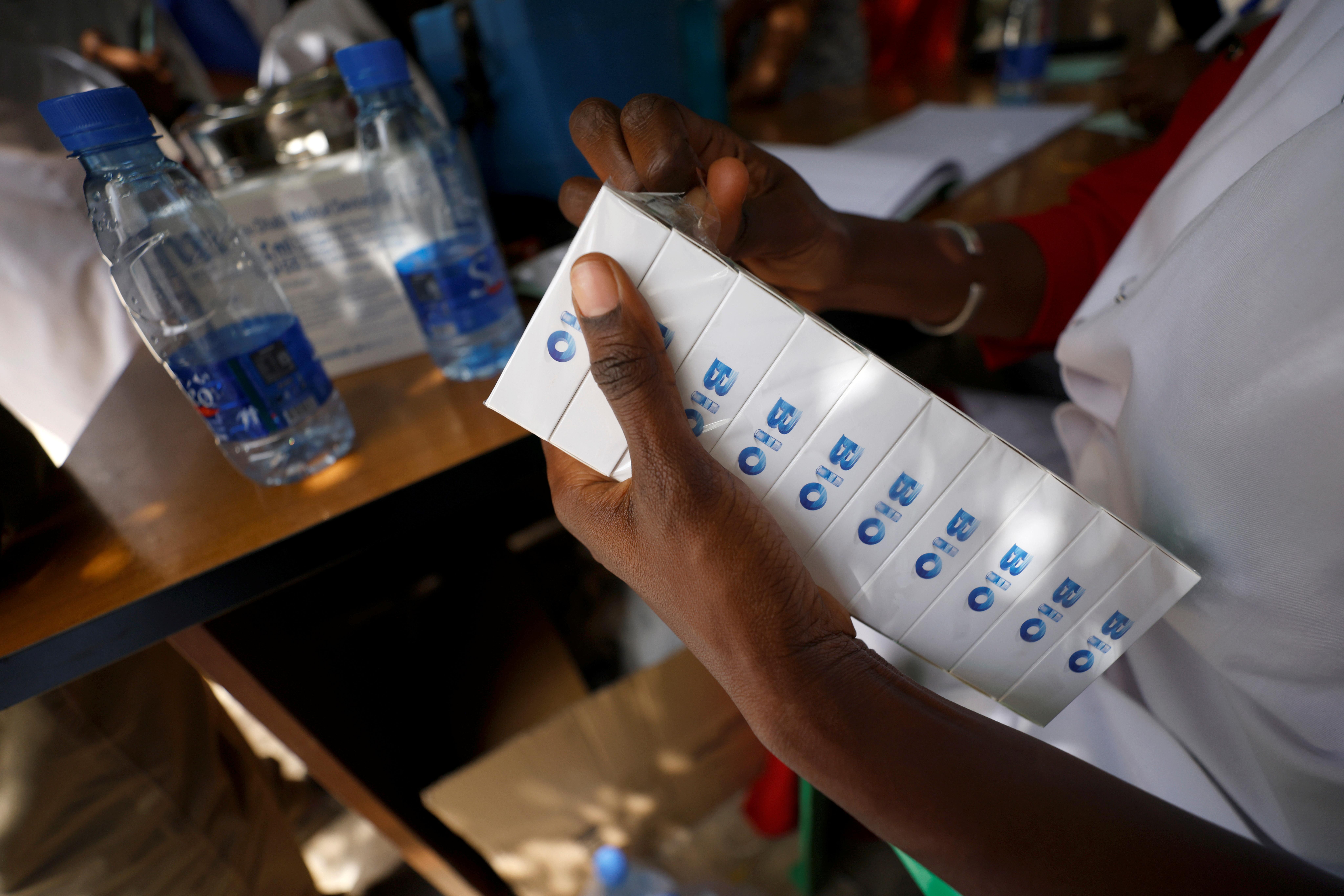 A health worker  prepares doses of coronavirus disease (COVID-19) vaccine in Dakar, Senegal February 24, 2021. REUTERS/ Zohra Bensemra