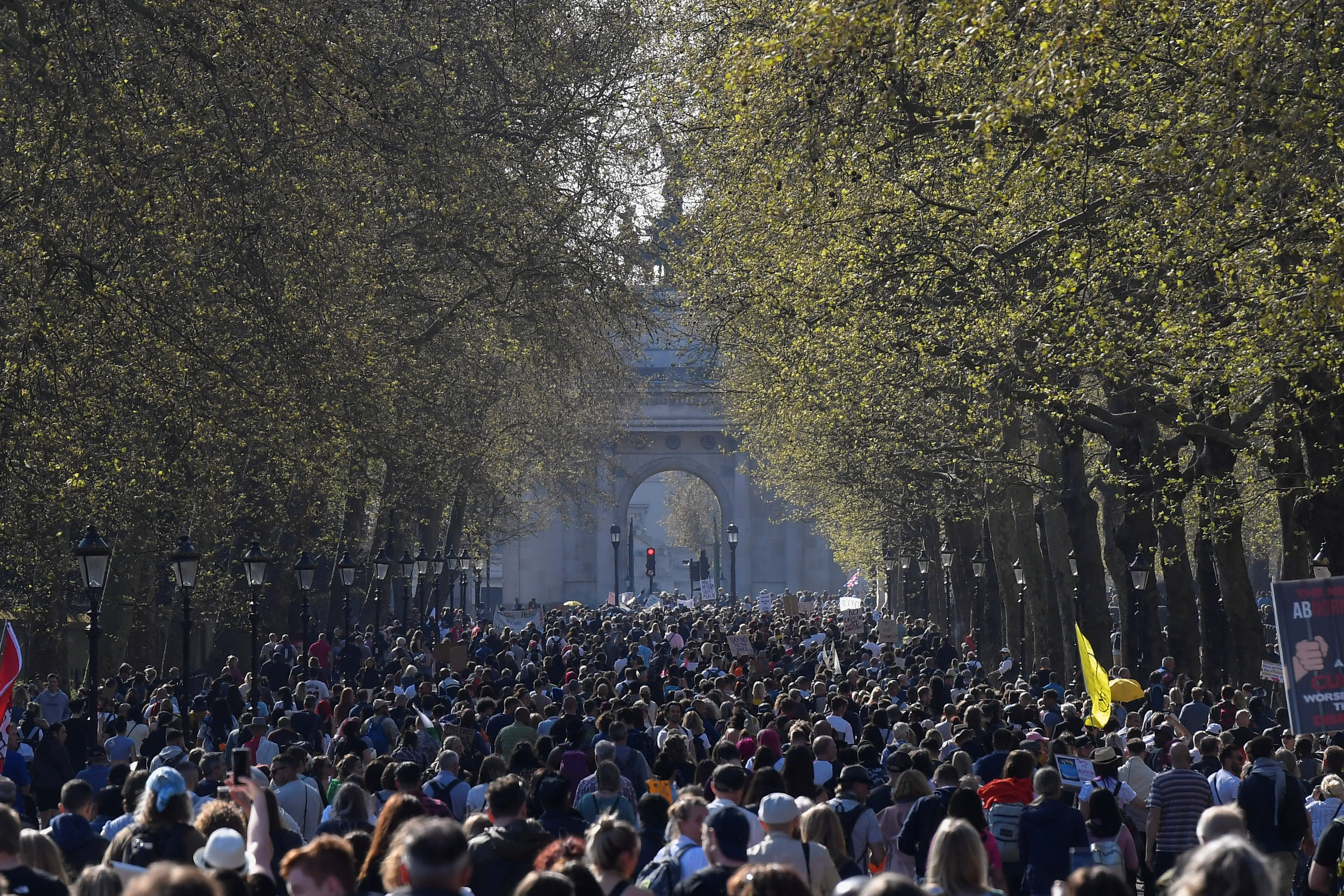 Demonstrators march during an anti-lockdown 'Unite for Freedom' protest, amid the spread of the coronavirus disease (COVID-19), in London, Britain, April 24, 2021. REUTERS/Toby Melville