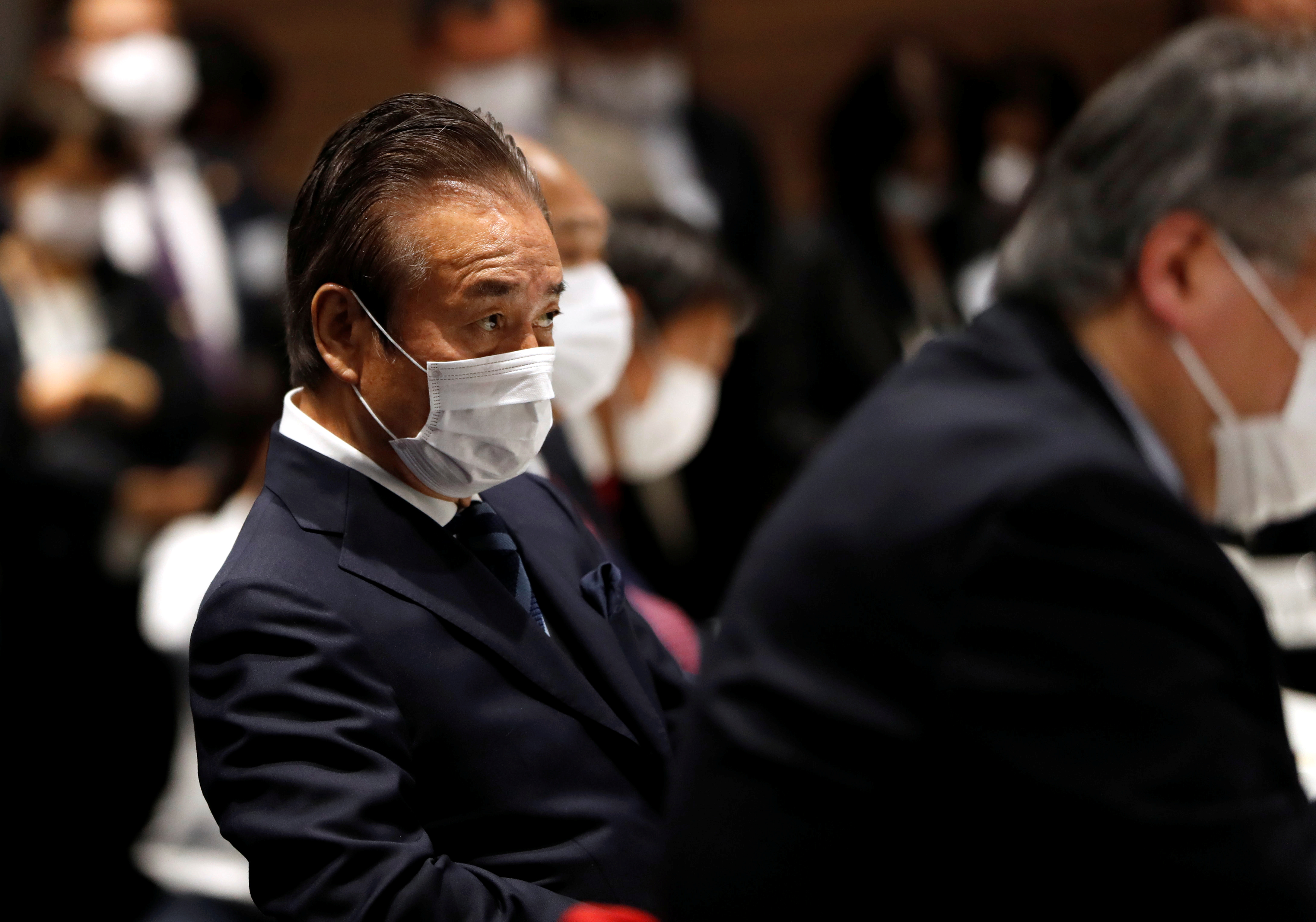 The Tokyo Organising Committee of the Olympic and Paralympic Games (Tokyo 2020) Executive Board member Haruyuki Takahashi, wearing a protective face mask following an outbreak of the coronavirus disease (COVID-19), is seen during Tokyo 2020 Executive Board Meeting in Tokyo, Japan March 30, 2020.  REUTERS/Issei Kato/Pool