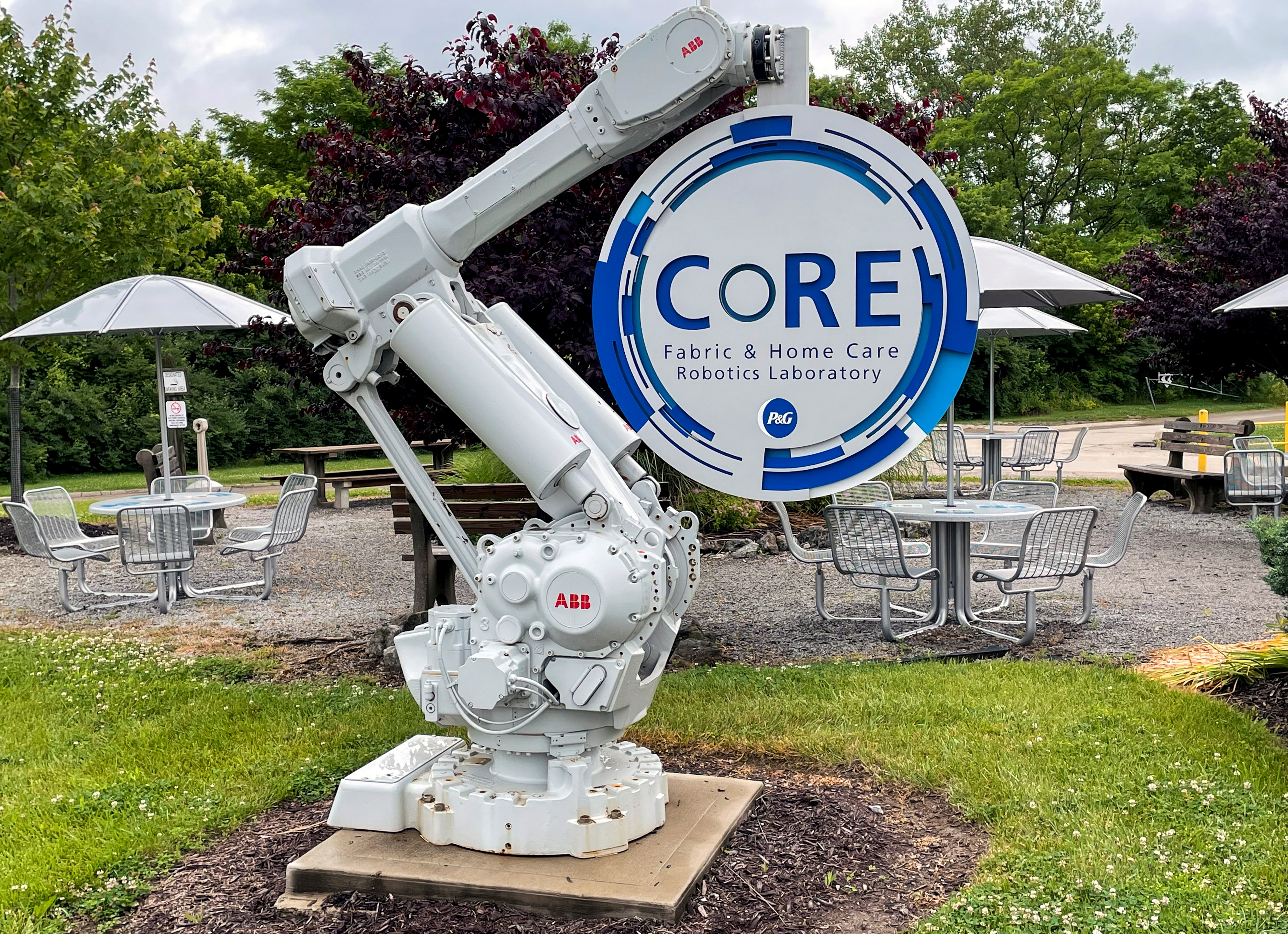 A robotic arm holds a sign for Procter & Gamble's CoRE Fabric and Home Care Robotics Laboratory in Cincinnati, Ohio, U.S., May 27, 2021. Picture taken May 27, 2021. REUTERS/Timothy Aeppel