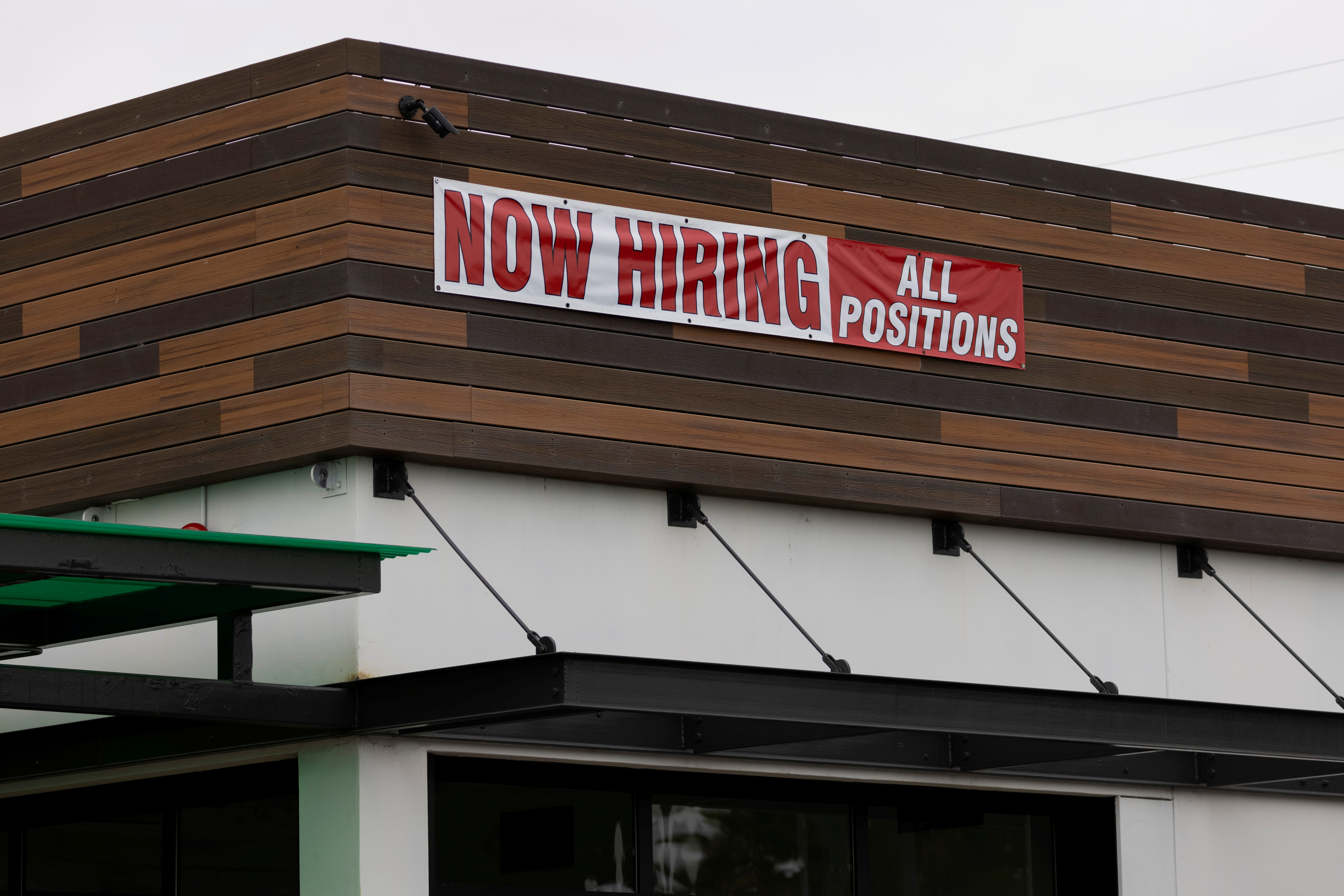 A restaurant advertising jobs looks to attract workers in Oceanside, California, U.S., May 10, 2021. REUTERS/Mike Blake/File Photo