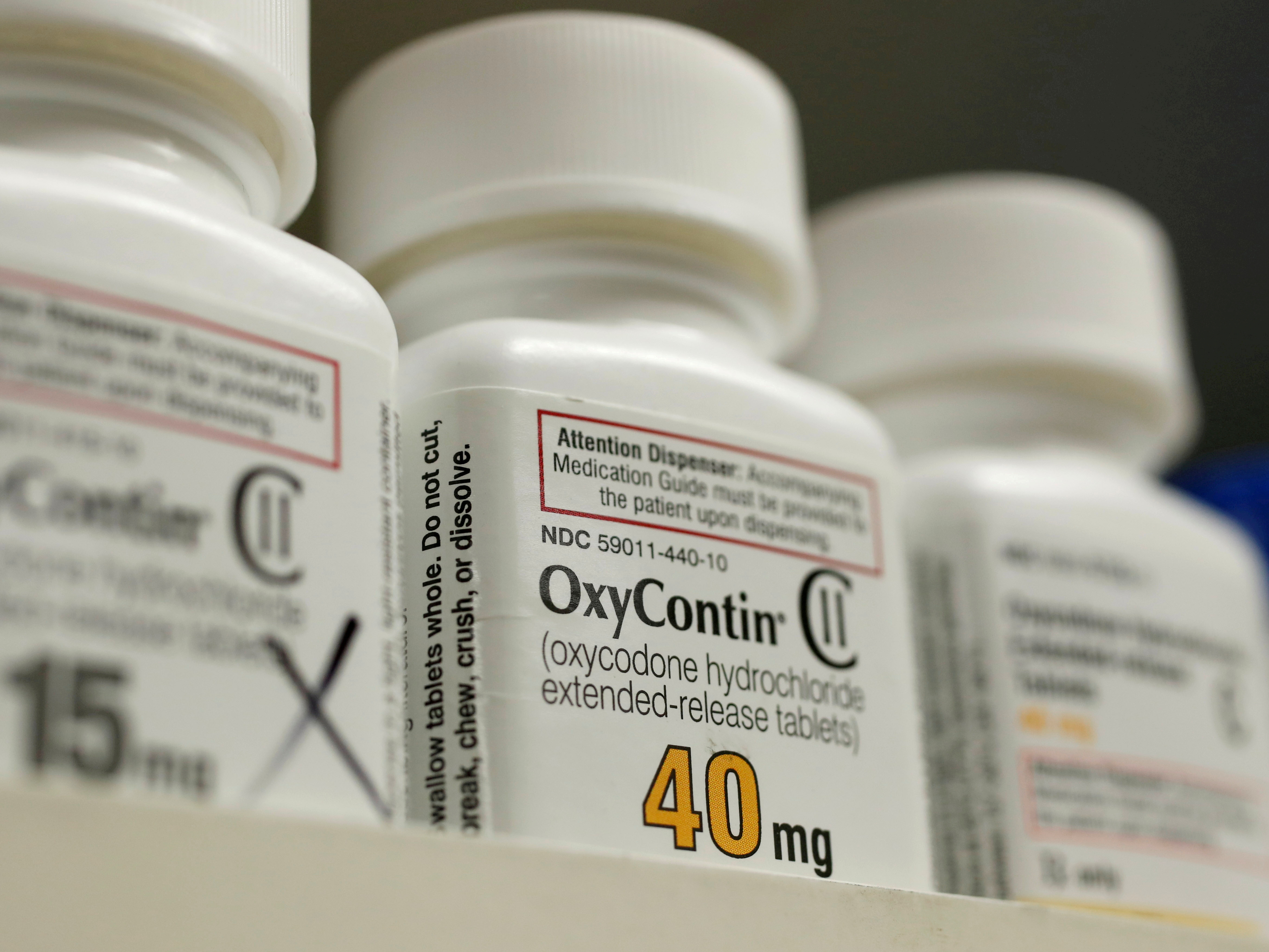 Bottles of prescription painkiller OxyContin made by Purdue Pharma LP sit on a shelf at a local pharmacy in Provo, Utah, U.S. April 25, 2017.   REUTERS/George Frey/File Photo
