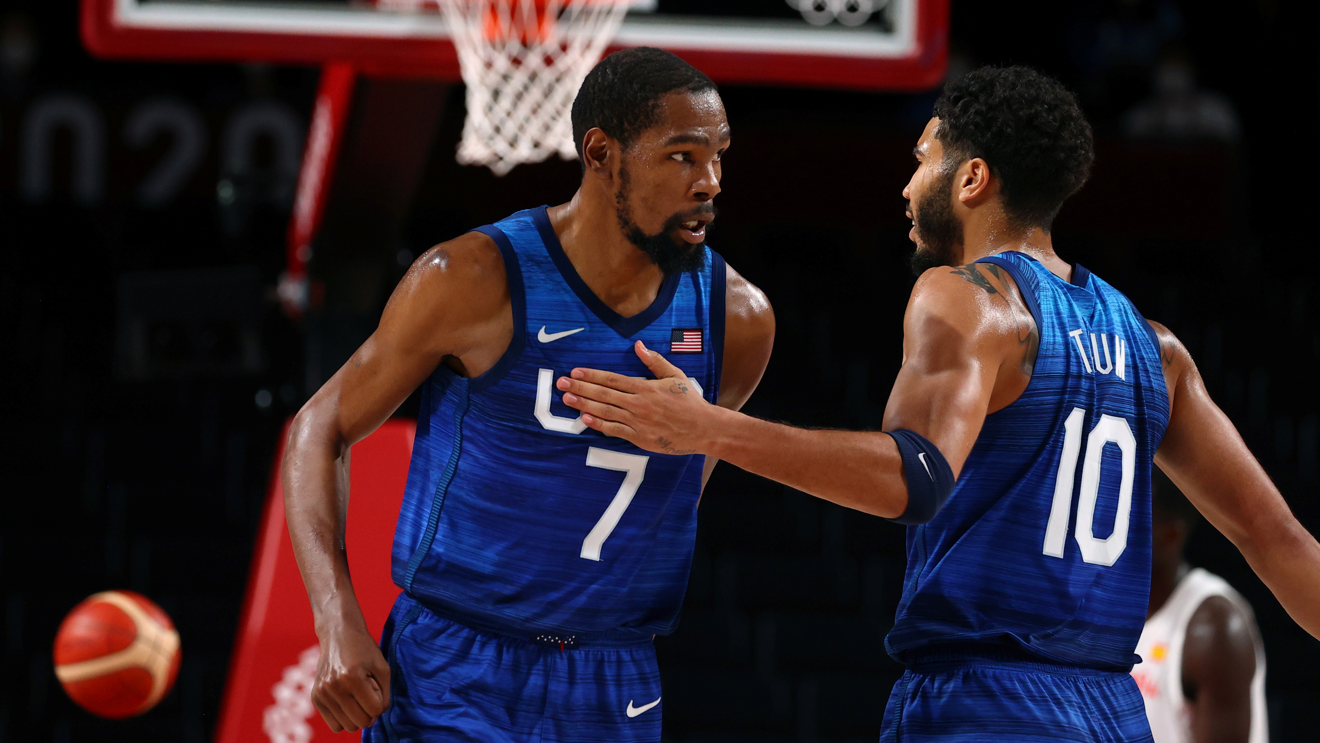 Tokyo 2020 Olympics - Basketball - Men - Quarterfinal - Spain v United States - Saitama Super Arena, Saitama, Japan - August 3, 2021. Kevin Durant of the United States celebrates after scoring a basket with Jayson Tatum of the United States REUTERS/Brian Snyder