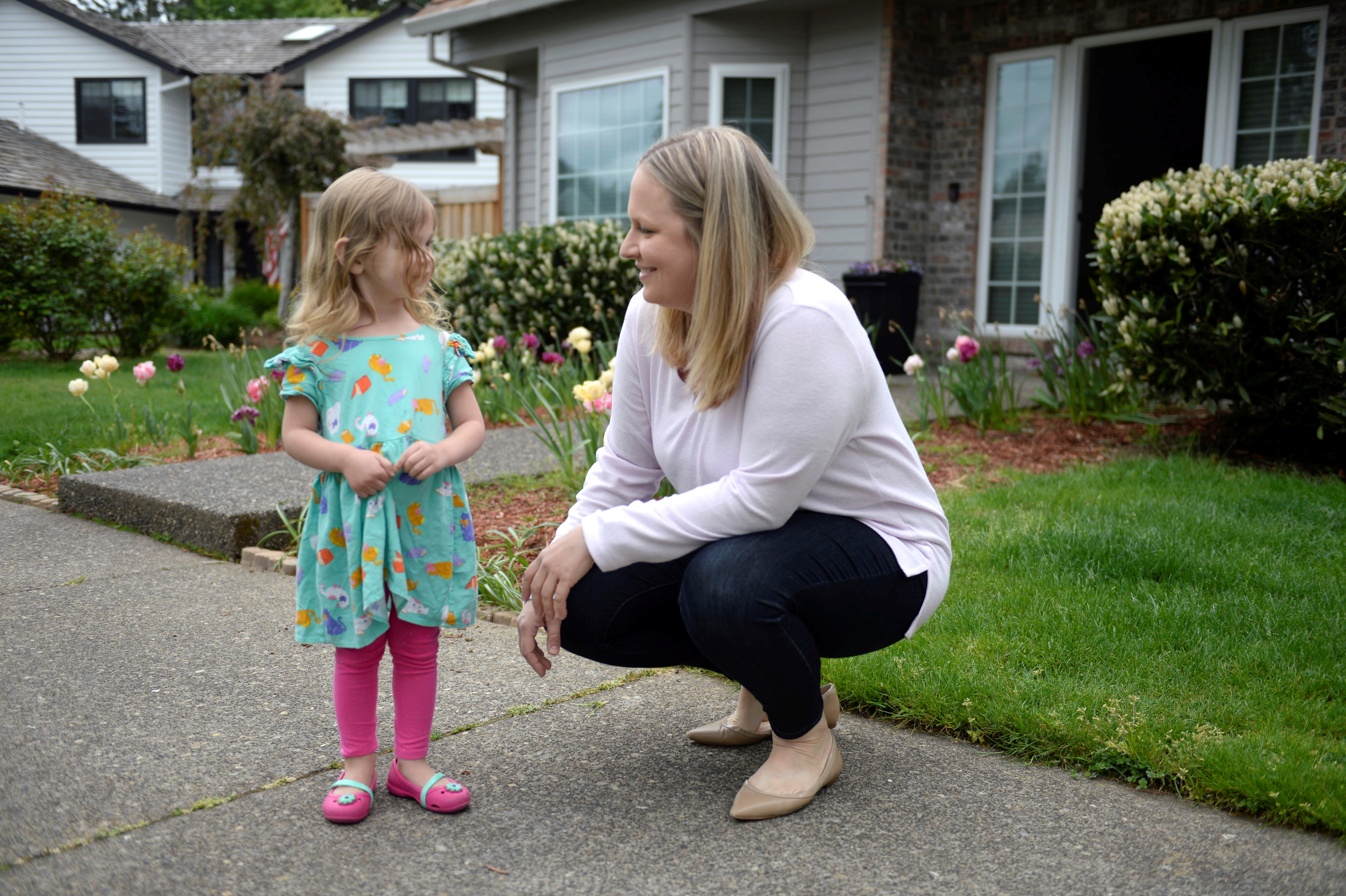Mother of two, Wendy Niculescu, poses for a photo with her daughter Eleanor in Tualatin, Oregon, U.S., May 1, 2021. REUTERS/Amanda Lucier
