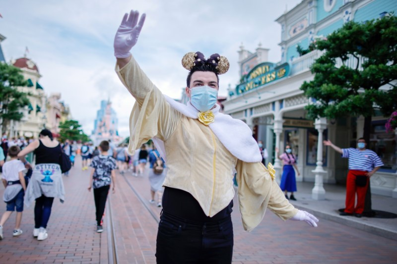 A visitor wears a protective face mask at Disneyland Paris as the theme park reopens its doors to the public in Marne-la-Vallee, near Paris, following the coronavirus disease (COVID-19) outbreak in France, June 17, 2021. REUTERS/Gonzalo Fuentes
